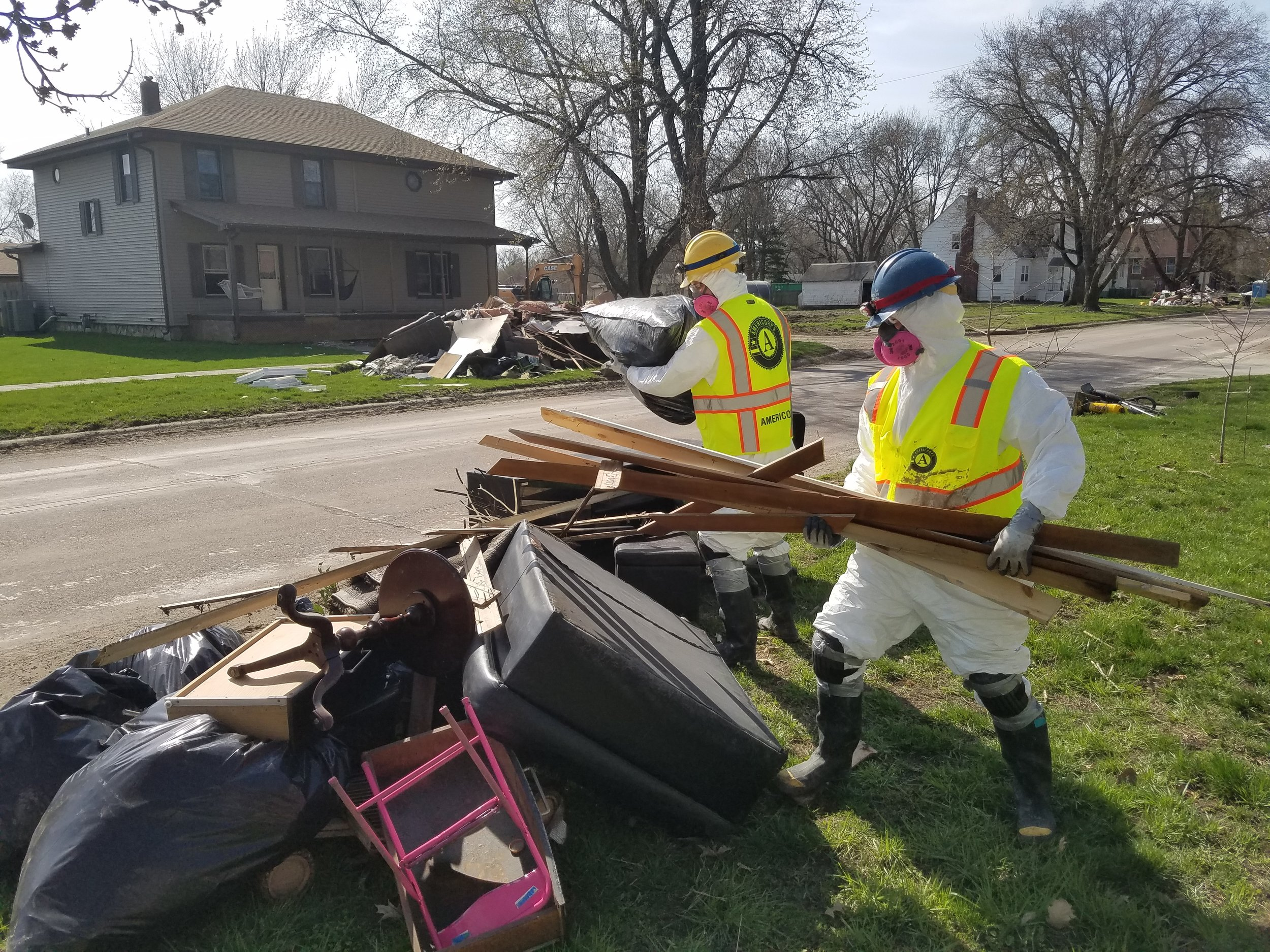 In April 2019, AmeriCorps members helped residents remove debris and personal items from homes damaged by flooding in Hamburg, Iowa.