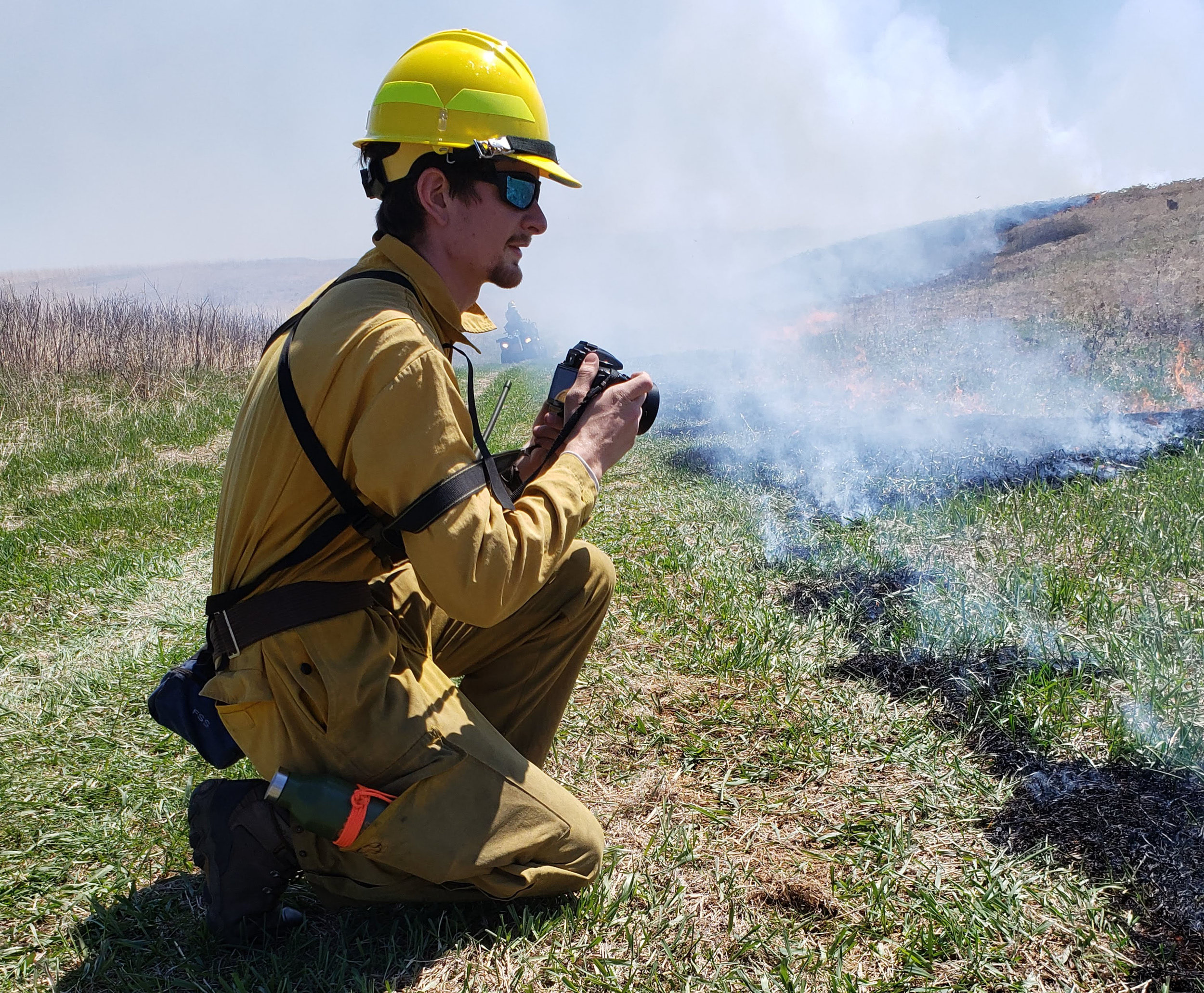 Me, taking photos and videos of a prescribed burn for a before/after project showing the benefits of prescribed burning.