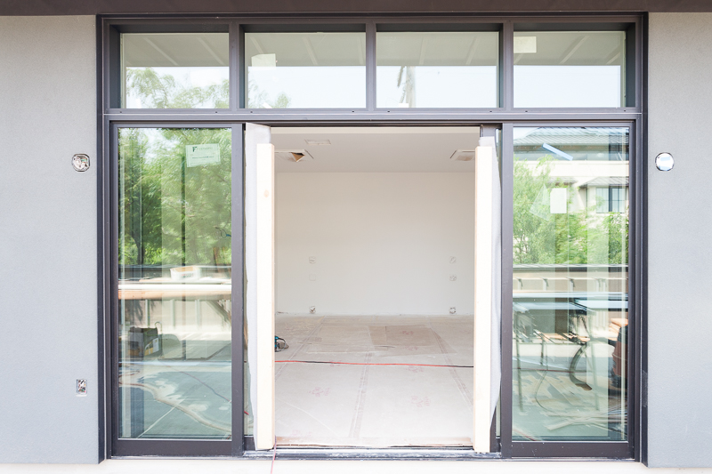 The windows and French doors of the master bedroom in the east unit.
