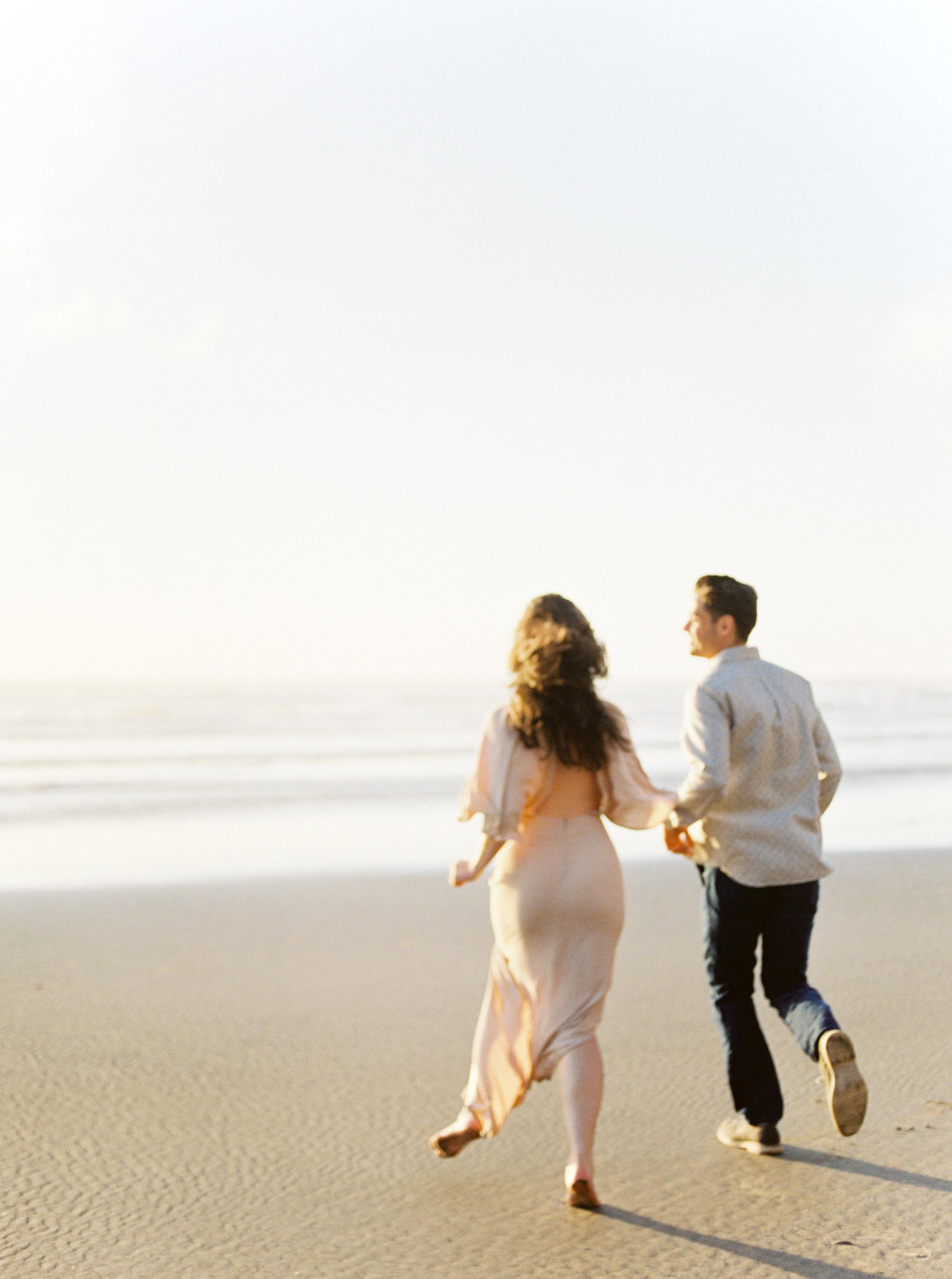 Engagement Photos at Oregon Coast while running on beach