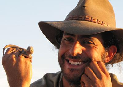 Ecologist George Madani displays a small reptile, 2010.