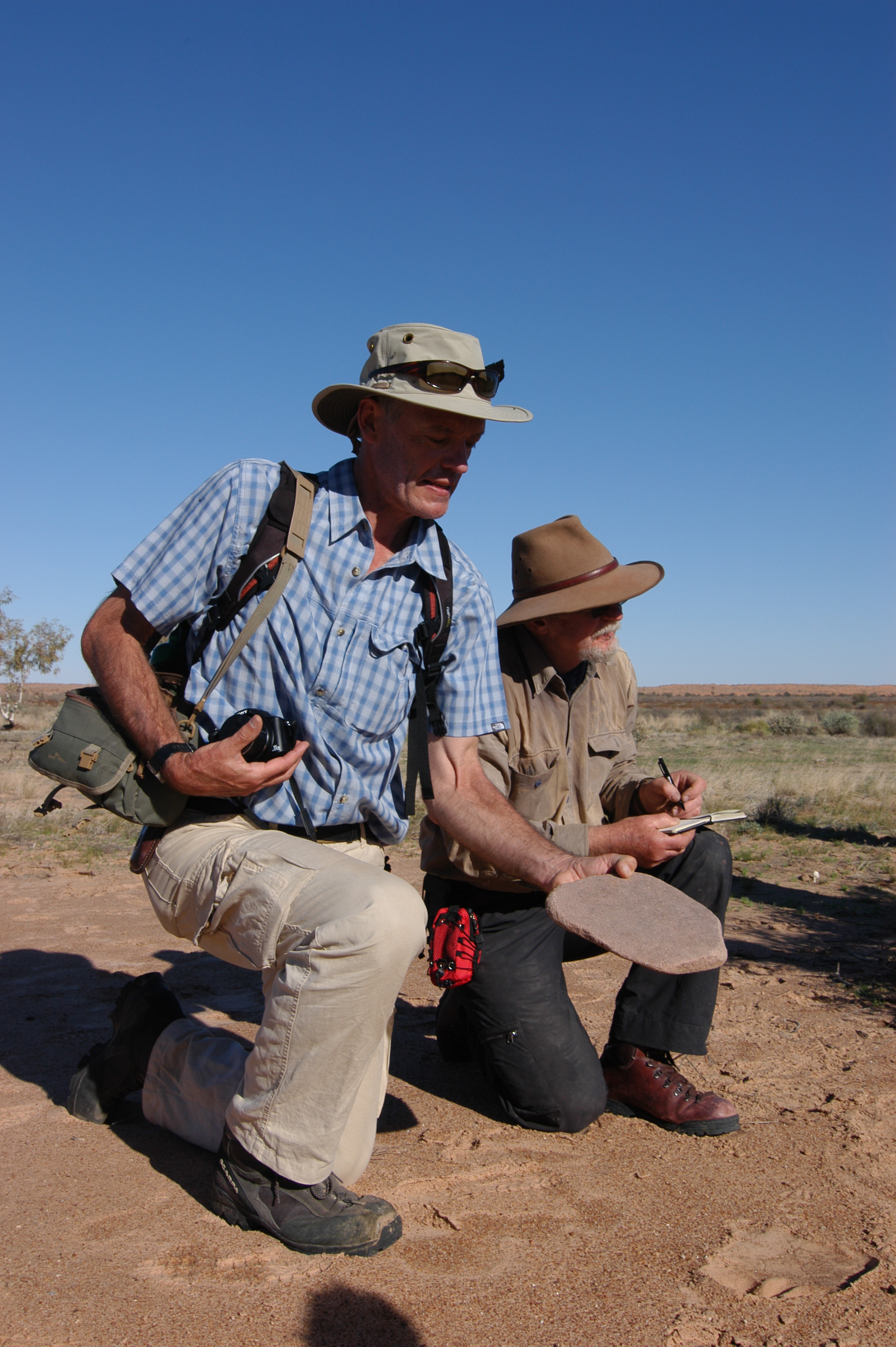 Dr's Philip Jones and Mike Smith examine artefacts.
