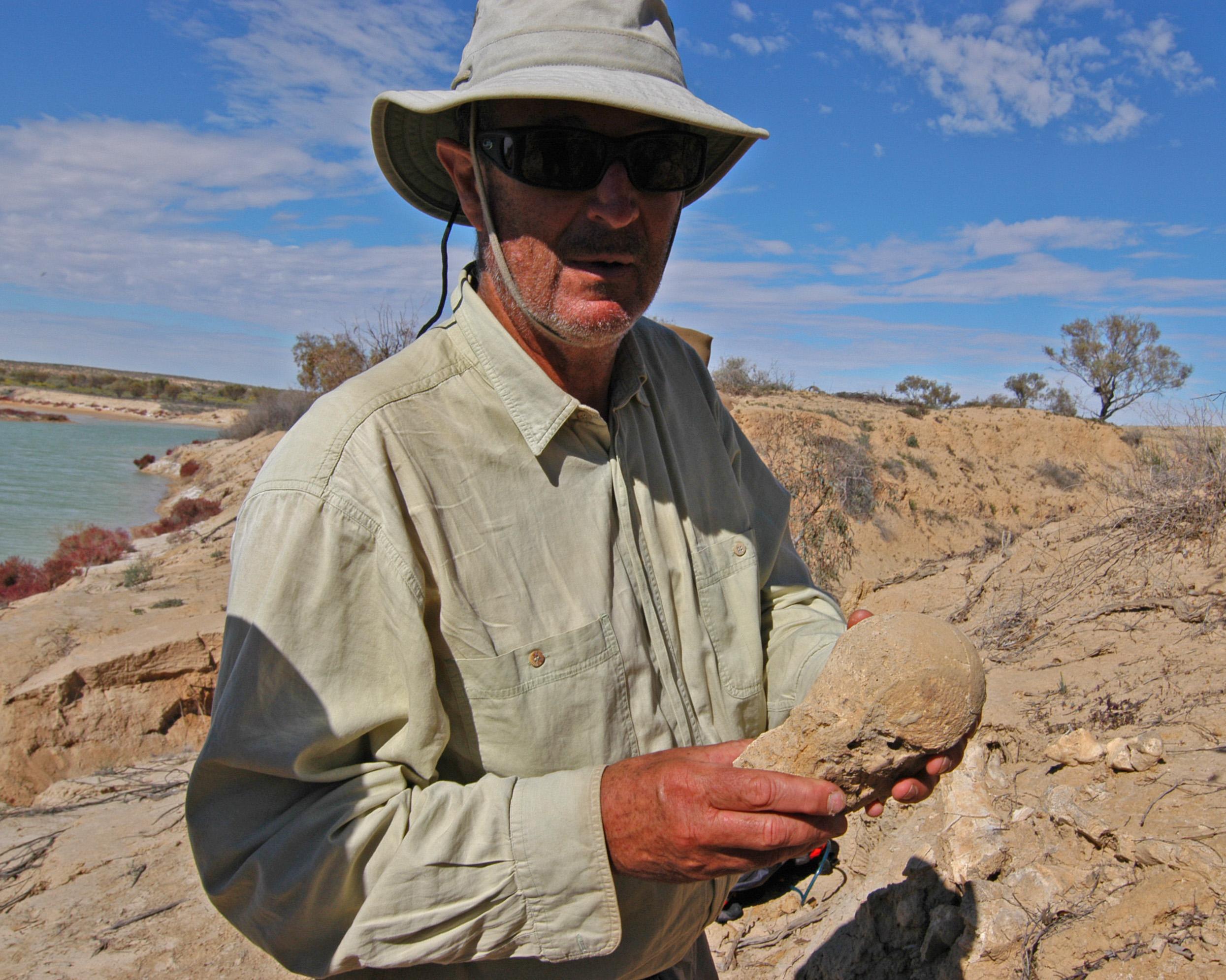 The expedition doctor examines a fossilised megafauna bone.
