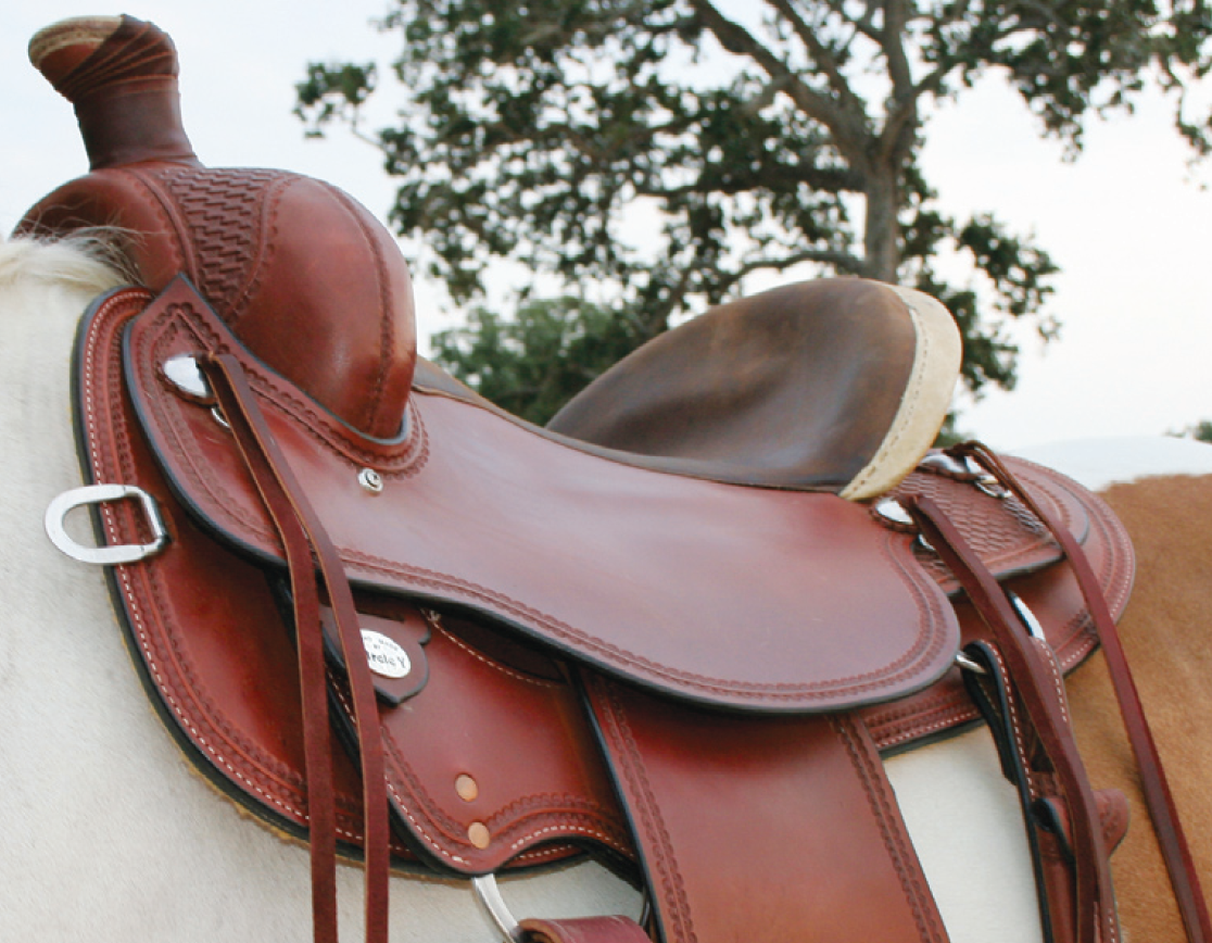 RIGHT: Saddle is too wide with gullet resting on horse's withers and tilted downward.