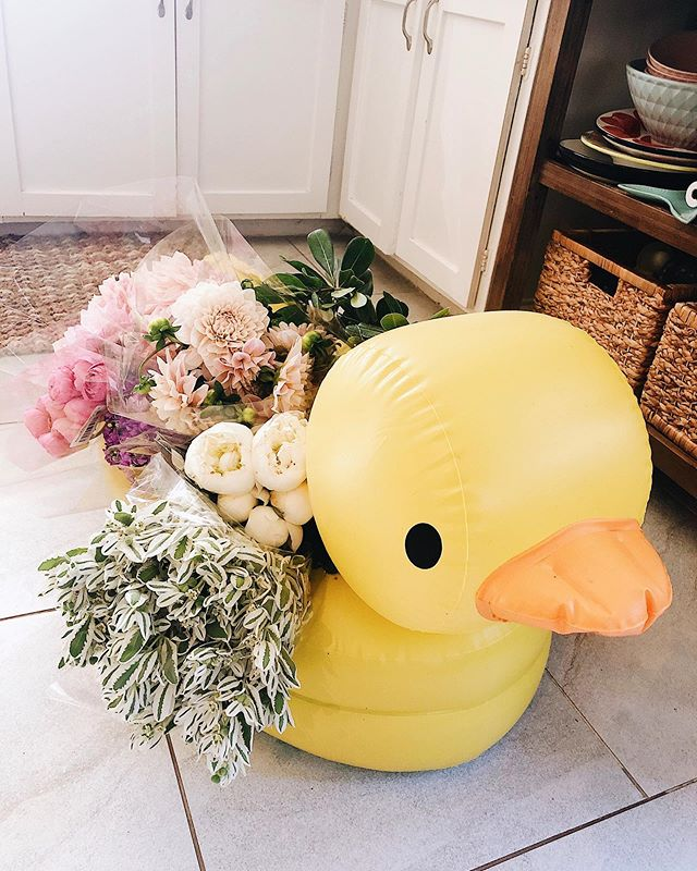 When you can't find your flower bucket so you use your kid's inflatable duck bathtub. #momlife