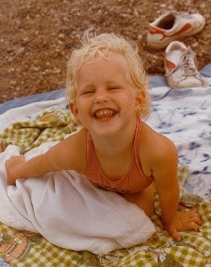 This is me as a child. You must pretend I am playing in a sandbox because I couldn't find a picture of me in a sandbox for this post.