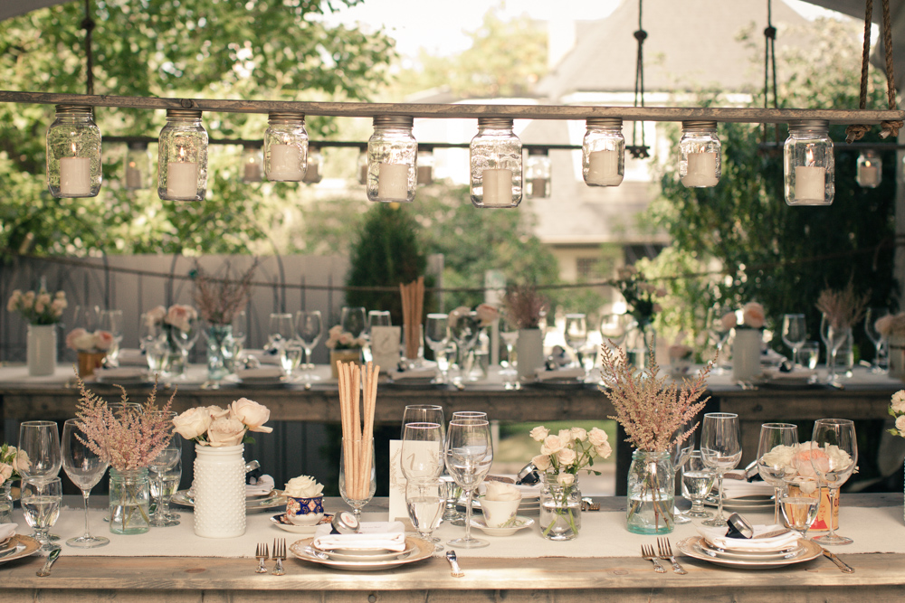 Stunning dining tables waiting for family-style dinner service. Photo by Gary Ashley of The Wedding Artists Collective