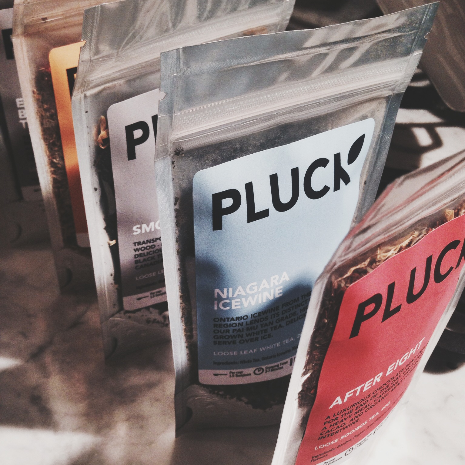 "These  Pluck teas  caught my eye as well. Check out these flavors. Niagara Icewine. Is this a joke? I need this. Right now. The one behind it is ""Smoky Maple"" which sounds the perfect ""windows-open-reading-a-book-fall-time"" tea. But seriously... Niagara Icewine. I need this."
