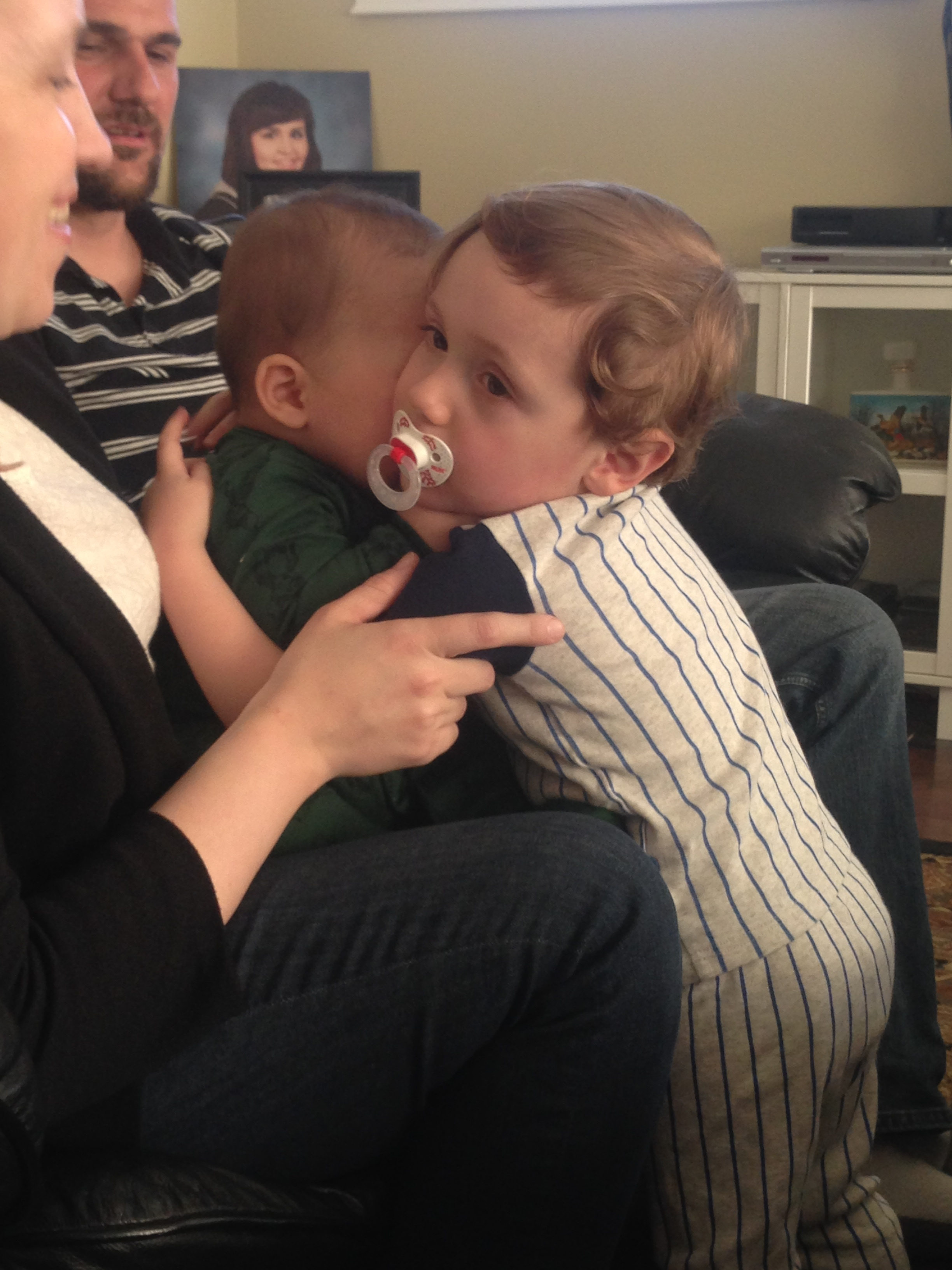 Also look at this pic of my nephew hugging his baby cousin for the first time. B'AWW. Also don't look at the pic of me from graduation in the background, lol. #bangs