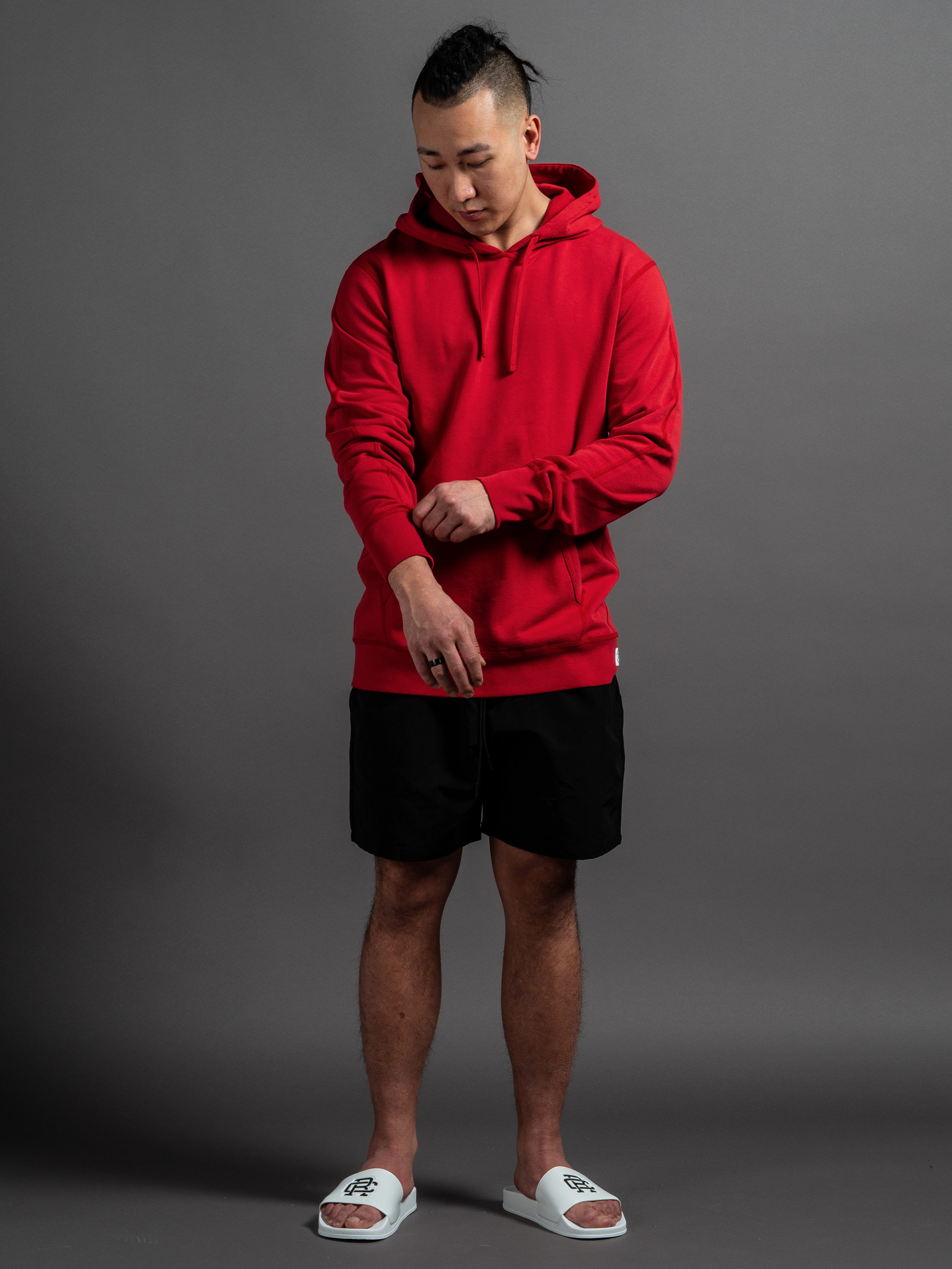 Reigning Champ Lightweight Pullover  Reigning Champ Swim Shorts  Reigning Champ Slides    SHOP THIS LOOK