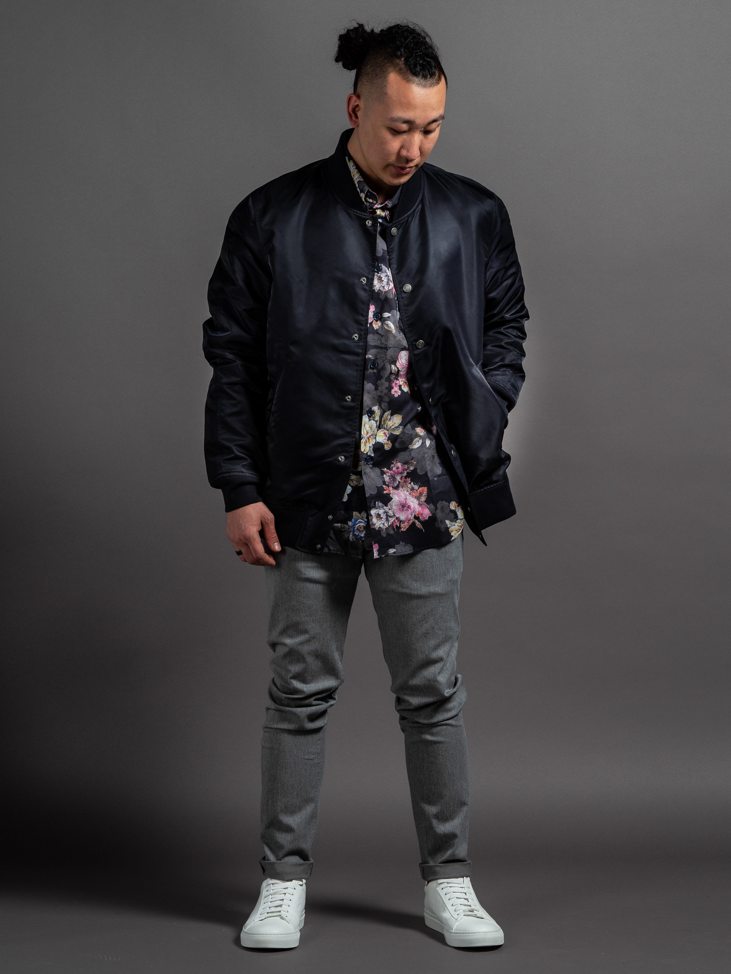 Reigning Champ Satin Stadium Jacket  Naked & Famous Flower Painting Shirt  Outclass Stretch Chinos  Wings + Horns White Court Sneakers    SHOP THIS LOOK