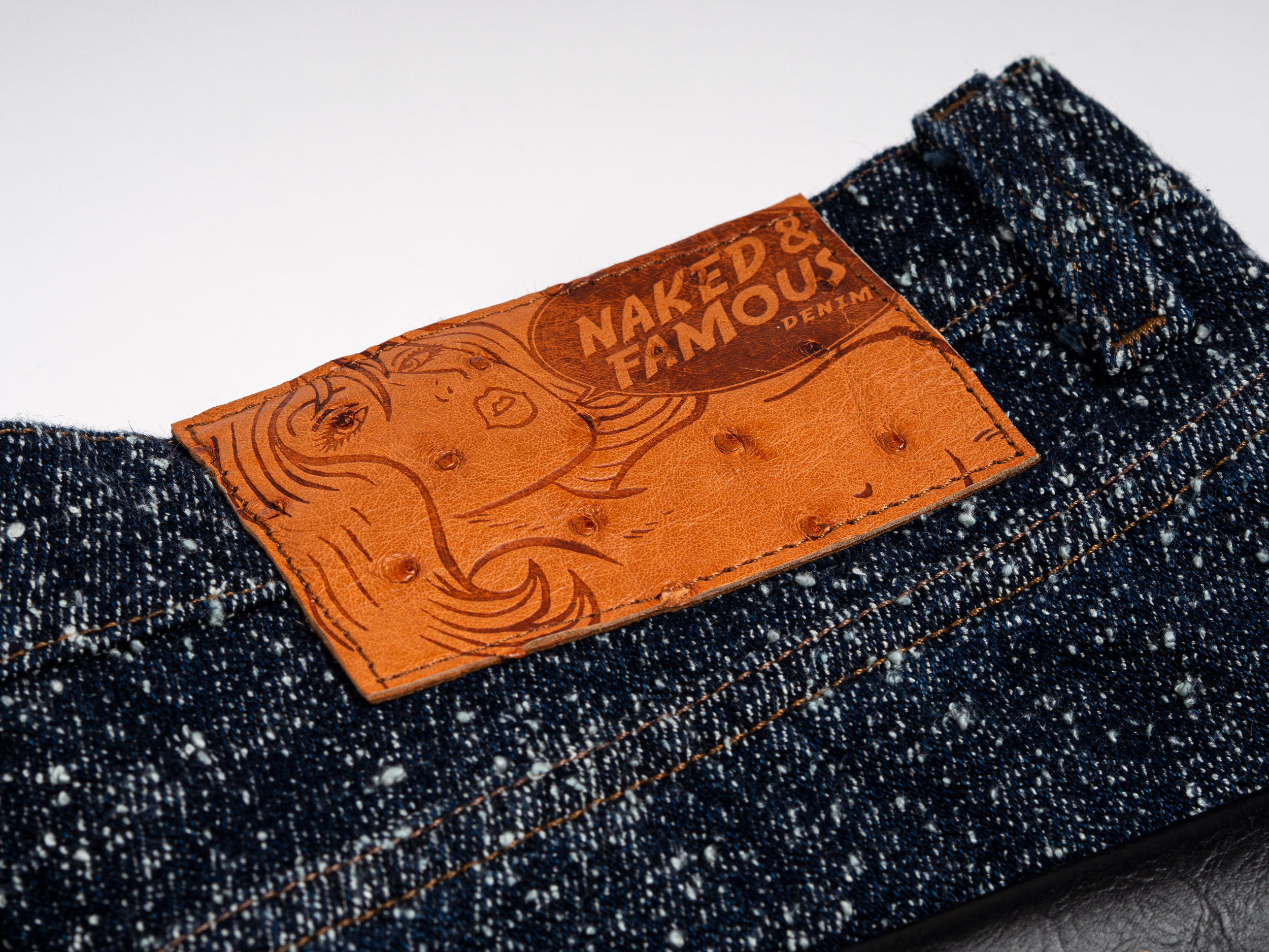 NAKED & FAMOUS LORD OF NEP SELVEDGE - The Lord of Nep Selvedge features a highly nepped 14.5oz Japanese denim which is made with a low tension weave, and deliberate knotting of the cotton yarn. As a result, the denim has a very three-dimensional appearance, and an extremely soft hand feel. The jeans are finished with an ostrich leather patch.