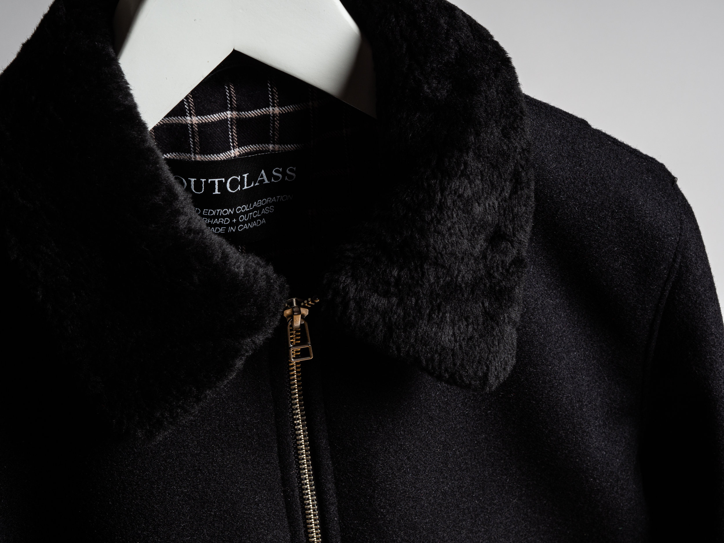 Outclass x GERHARD Aviator Jacket - Produced in very limited quantities, and a GERHARD exclusive, this collaborative aviator jacket features a melton wool body, and a classic aviator collar made with real shearling. The jacket is insulated with a soft checked flannel, and lined in the arms for easy on and off. The jacket is finished with a ribbed collar, cuffs and hem, and has an interior zip pocket for additional storage. As always, Outclass is Made in Canada.
