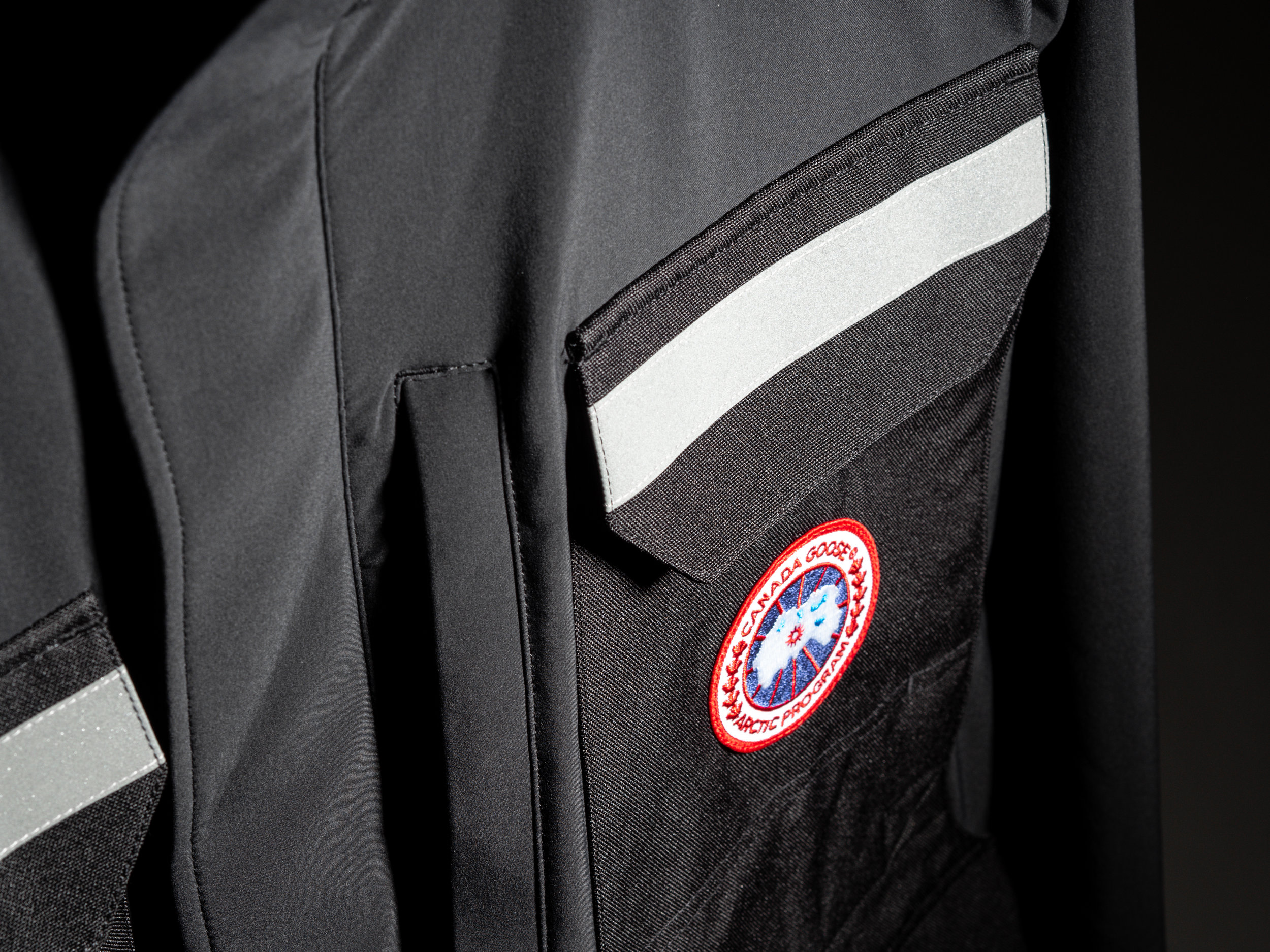Canada Goose Photojournalist Jacket - Designed for the traveling photographer, with smart storage in mind, the Photojournalist Jacket features eight exterior pockets: five on the front, two on the lower back, and one on the right sleeve. The jacket is reinforced with Cordura around the pockets and shoulders to guard against abrasion, and features reflective taping on the hood, chest, and back for safety. The Photojournalist Jacket is finished with a two-way zipper covered by a Velcro placket, side-seam ventilation zippers, and a stowable, waterproof hood.