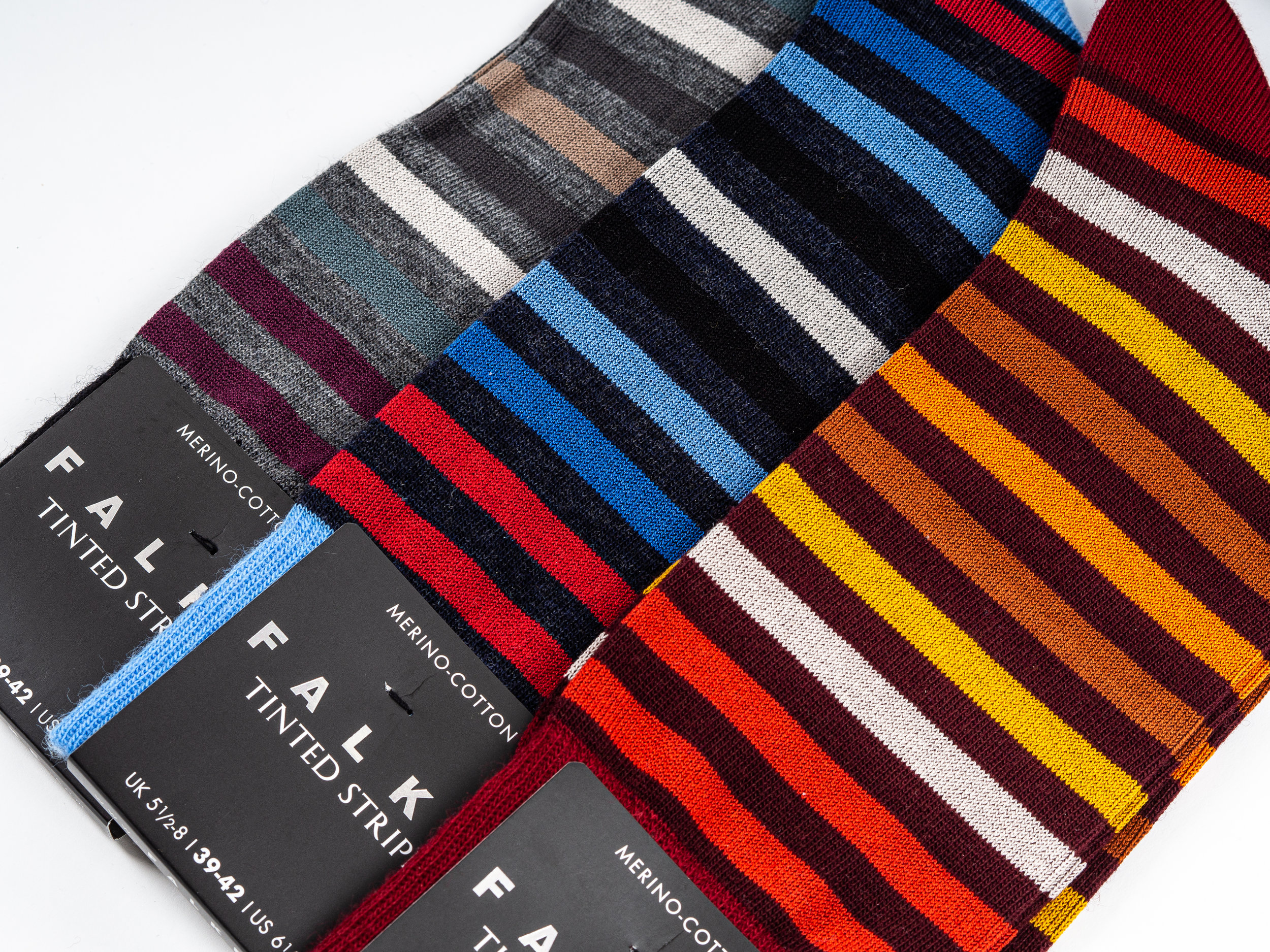 Falke Tinted Stripe Socks - These lightweight winter socks are made with virgin wool, and cotton. The wool yarn is faced outwards, providing warmth, moisture wicking, and temperature regulation, while the cotton yarn is faced inward, providing comfort on skin, especially for those who are sensitive to wool. They are anatomically fitted, with reinforced stress zones. Falke's Tinted Stripe Socks are made in the EU.