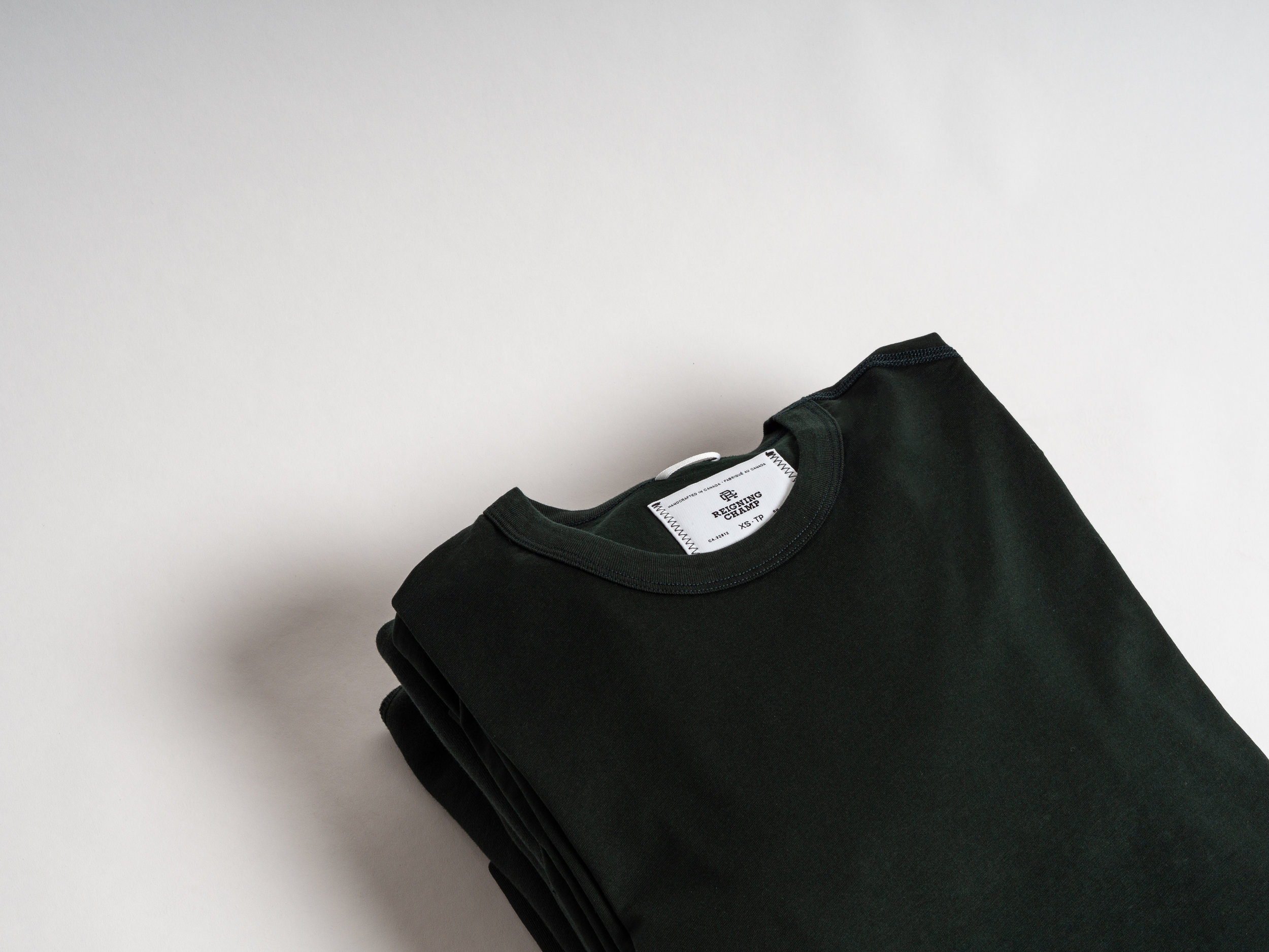 Reigning Champ Forest Green Pack - The core Midweight Terry and Ringspun Jersey offerings from Reigning Champ are now available in a seasonal Forest Green; part of their 2019 Varsity Pack. The pack is made with low-abrasion flat locked seams, and a durable 100% cotton rib for the highest level of comfort. The Varsity Pack is made in Canada.