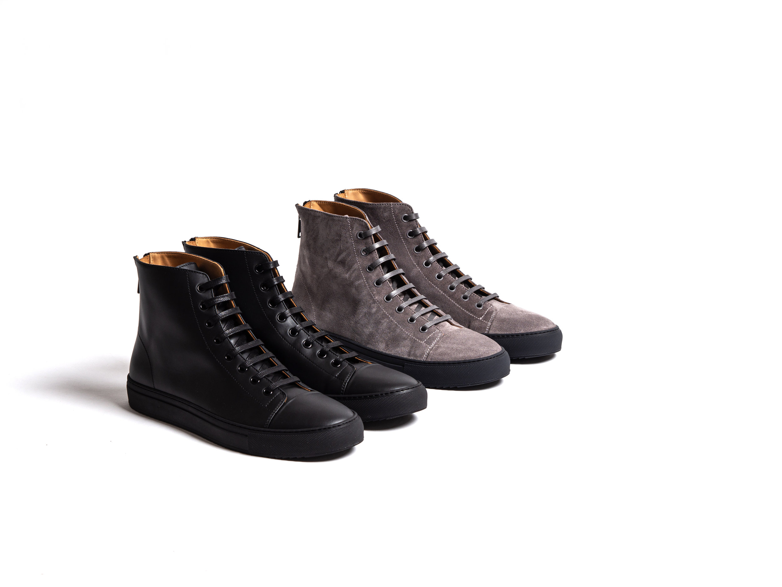 Outclass Italian Sneakers - Outclass' 2019 high-top trainers are a classic with modern styling. The black trainers are made with a luxurious smooth matte calfskin. The grey trainers are made with a finely sueded calf leather. Both styles are fully leather lined and feature zippers on the back for easy on and off. The Outclass high-top trainers are both made in Italy.