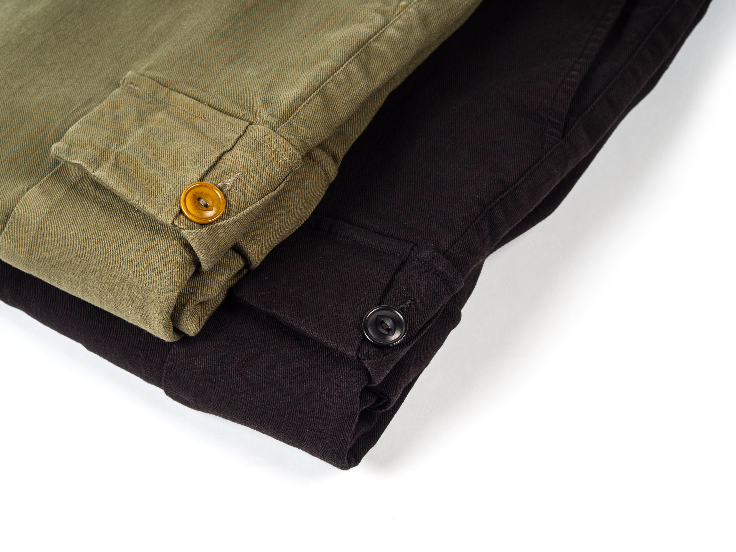 Outclass Garment Dyed Chinos - These Outclass Chinos were garment dyed and washed, post-construction, for a broken-in feel and a soft, uniform hue. They are blended with some stretch for mobility and comfort. The Chinos are a classic slim straight, and the Expedition Pants have cargo pockets, a full seat, and a sharp taper below the darted knees. Both styles feature double welt rear pockets and corozo nut buttons with a zip fly. Outclass bottoms are all made in Canada.