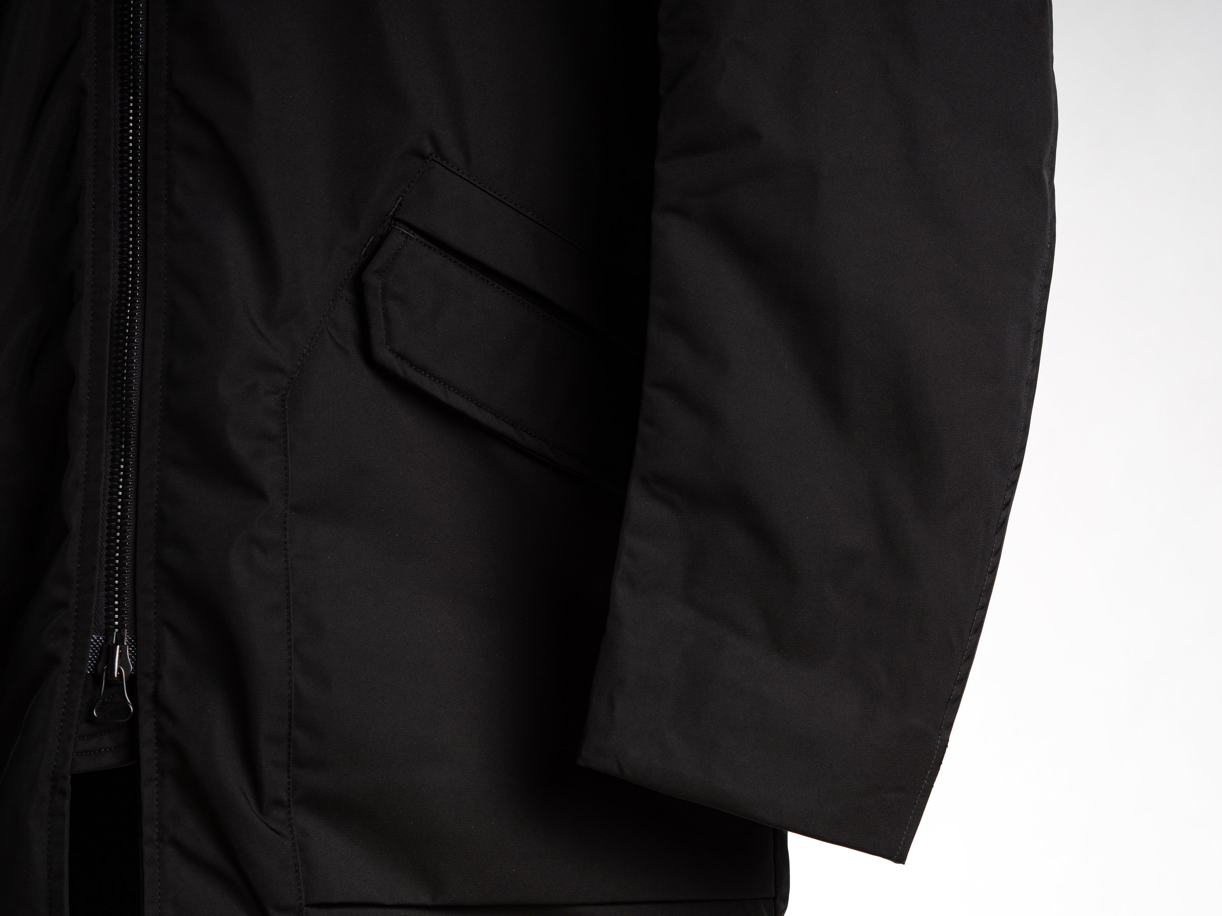 Wings + Horns Solo Twill Shearling Jacket - The Solo Twill Shearling Jacket from wings+horns pairs a densely woven Japanese nylon face fabric with a Polartec® fleece lining. The Japanese nylon breaks wind and water, while the Polartec® prevents heat loss, regulating core body temperature, all the while remaining durable and compact. The jacket is finished with double entry storm pockets, gusseted underarms, articulated sleeves, a hang tab on the yoke, and a two way RiRi zipper.