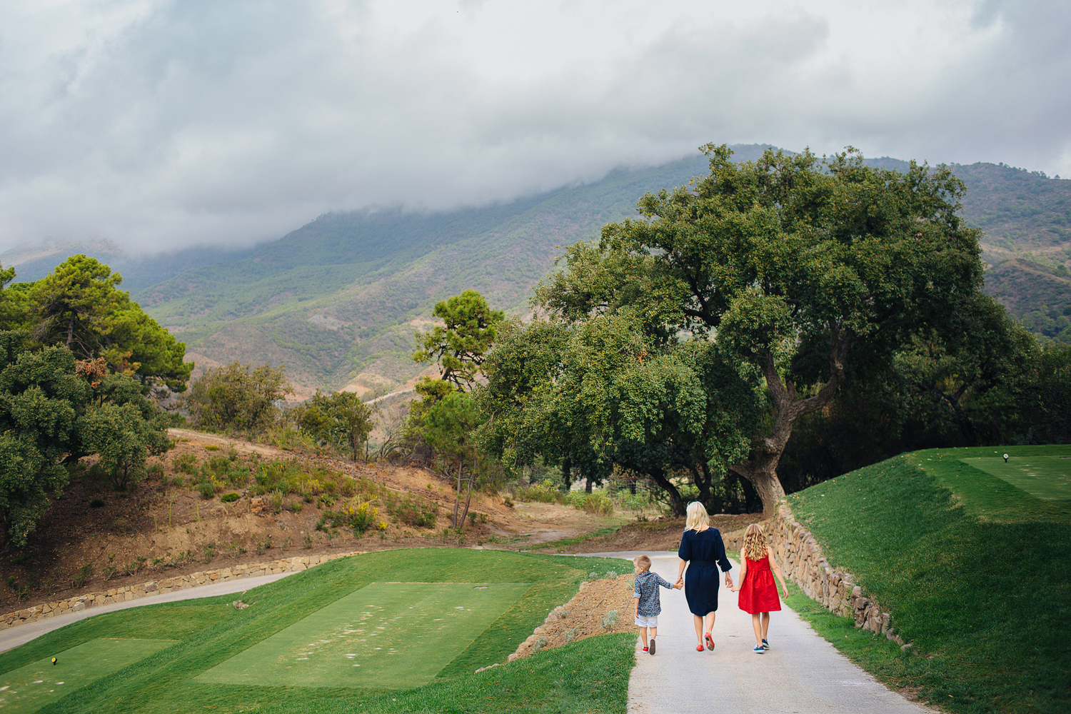 Destination Family Photography - family walking away in Marbella.jpg