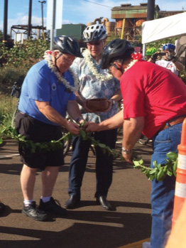 Pastor Lucky Ka'ahumanu blows the conch shell while Maui County Councilmember Don Couch, Managing Director Keith Regan and Councilmember Mike Victorino untie the ceremonial maile lei.