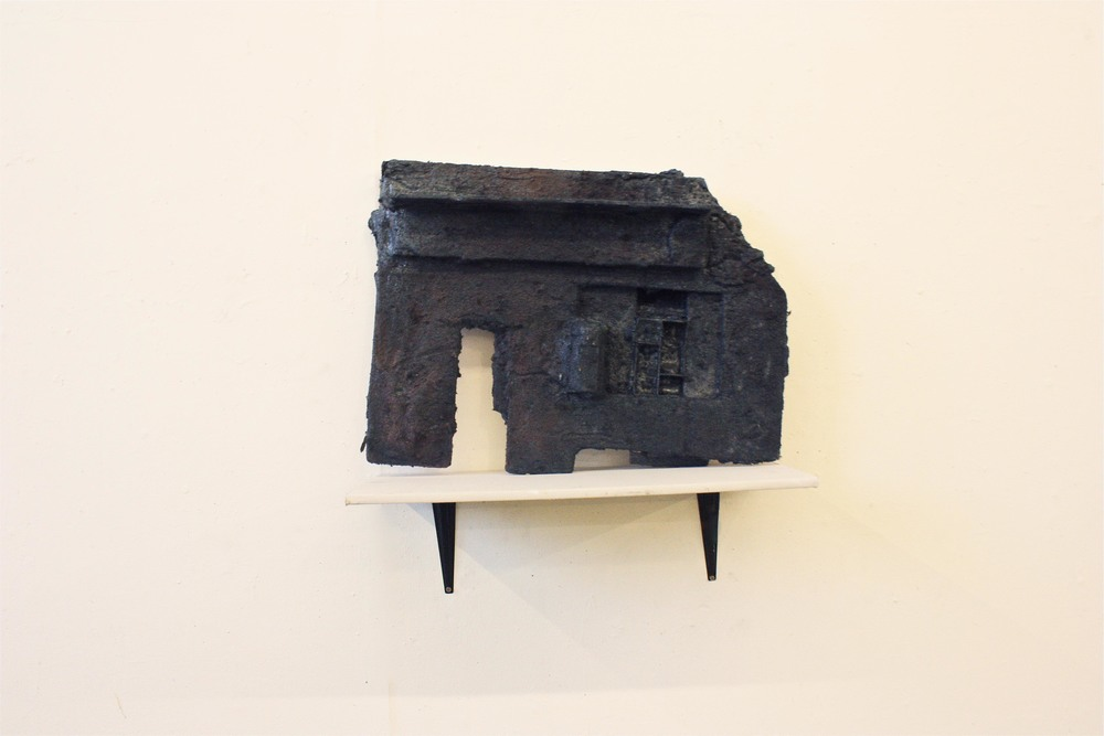 E shelf  2012  Enamel pigment, Spray Paint on sculpted wall sheeting foam  Dimensions vary