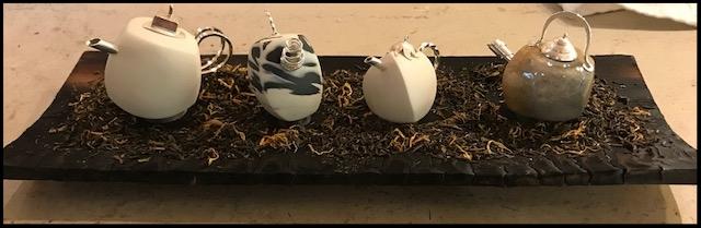 Tiny Silveramics tea pots