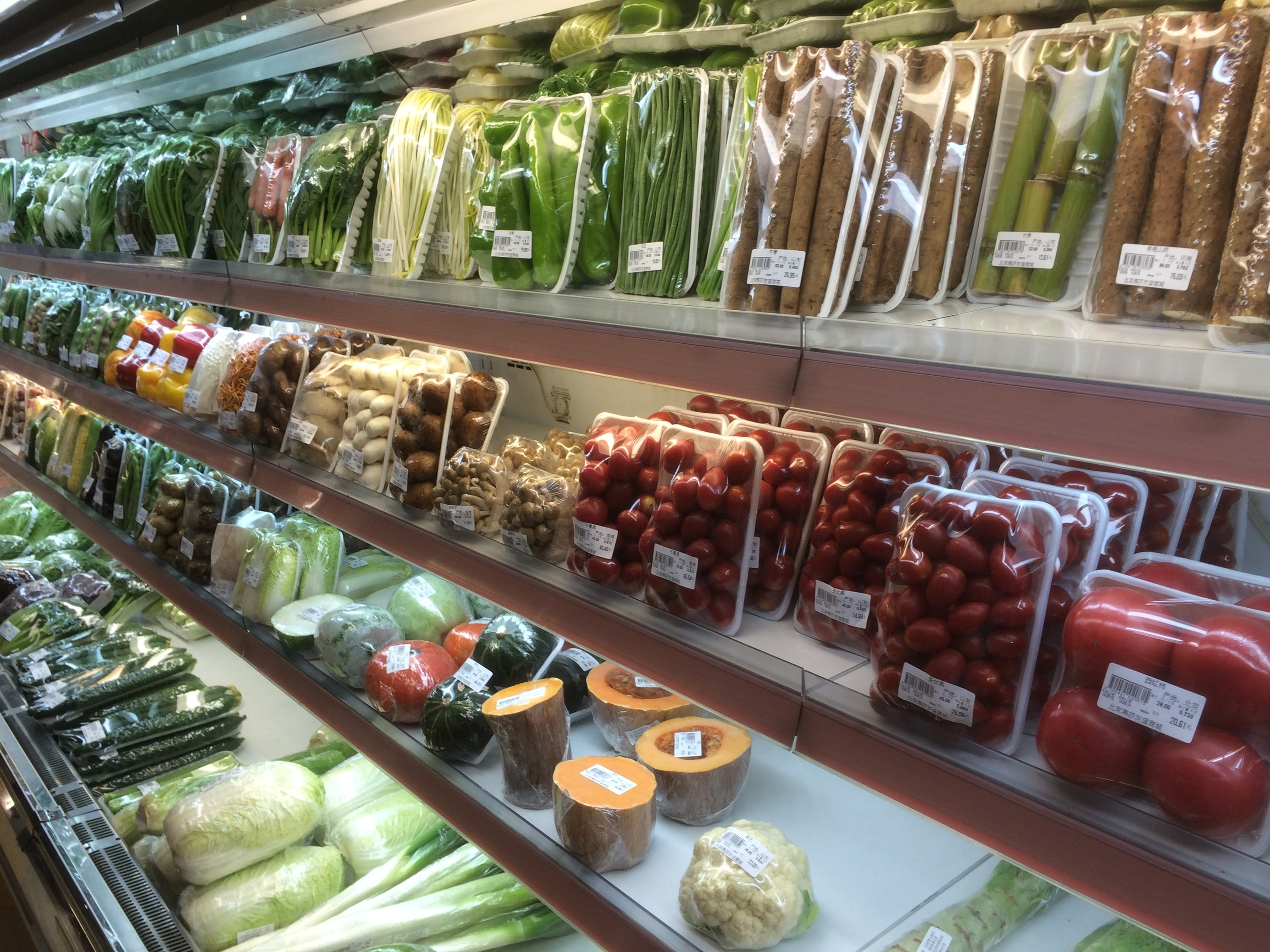 all of the produce in the store is wrapped up like this. certainly nice and tidy.