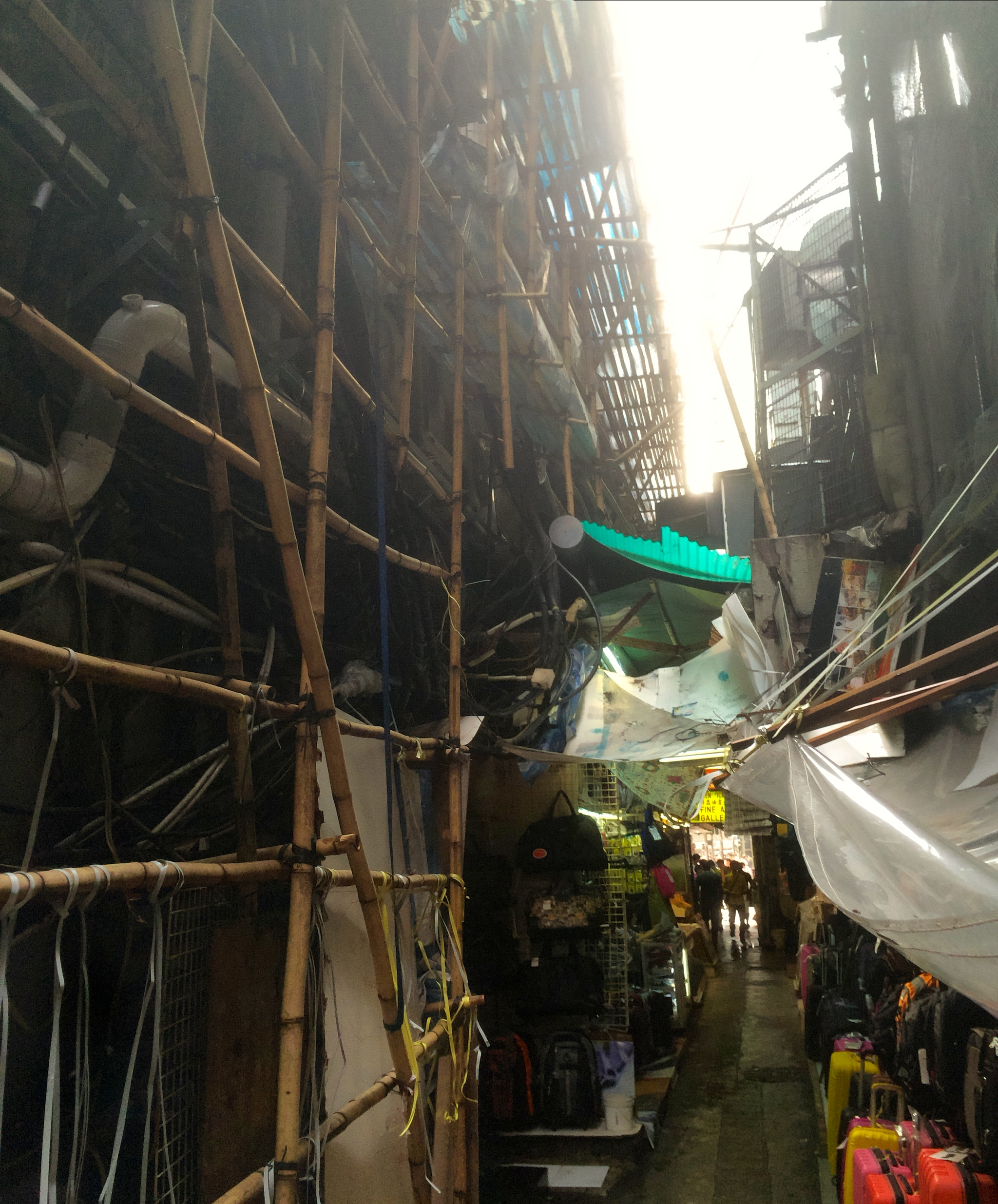 we decided to walk down this alley...and discovered this....a rats nest of bamboo scaffolding, tarps, and poorly rigged electrical wires. creepy, yes....and kinda cool.