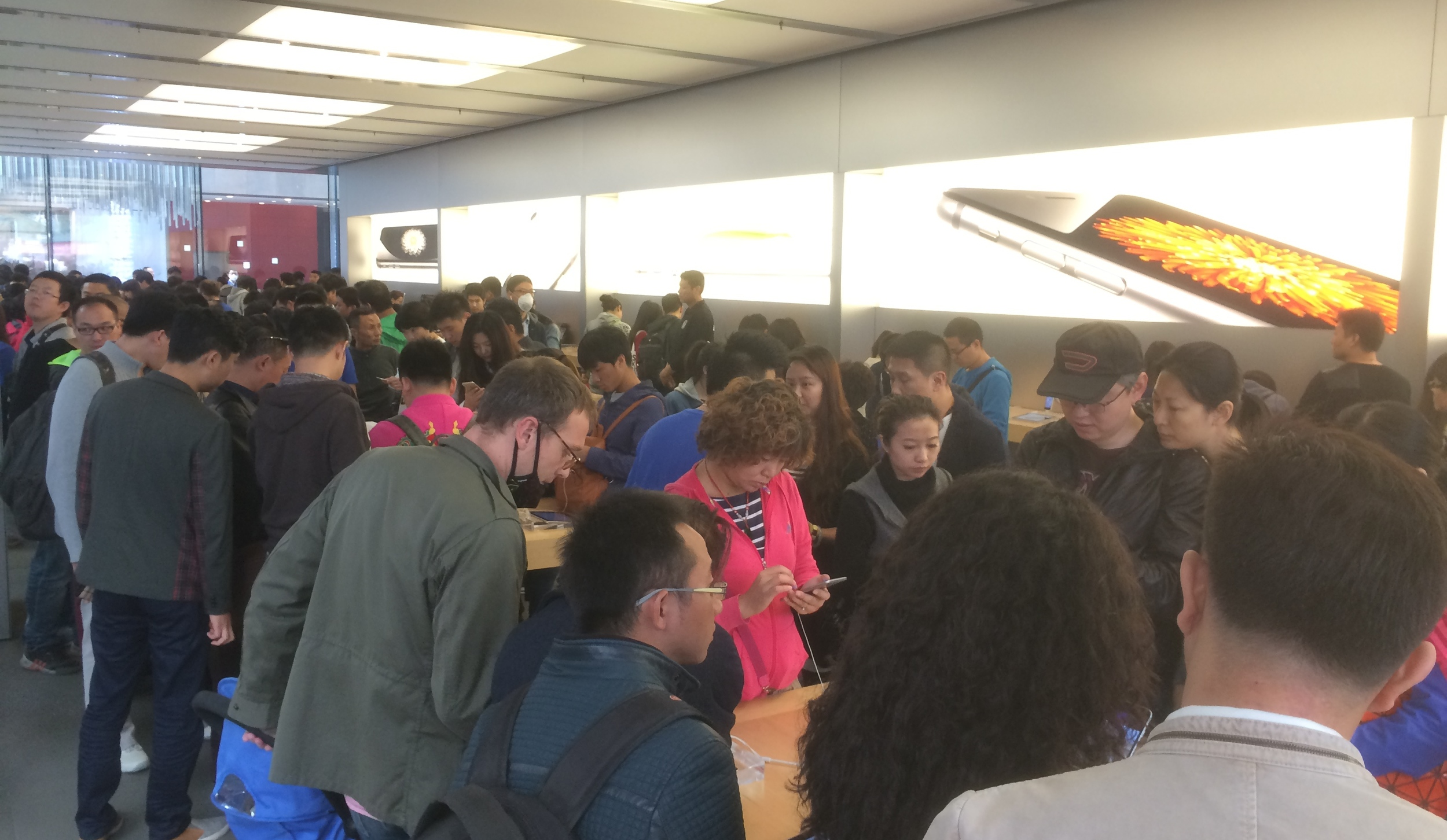 popped into the apple store today....this was the crowd checking out the recently released iPhone 6