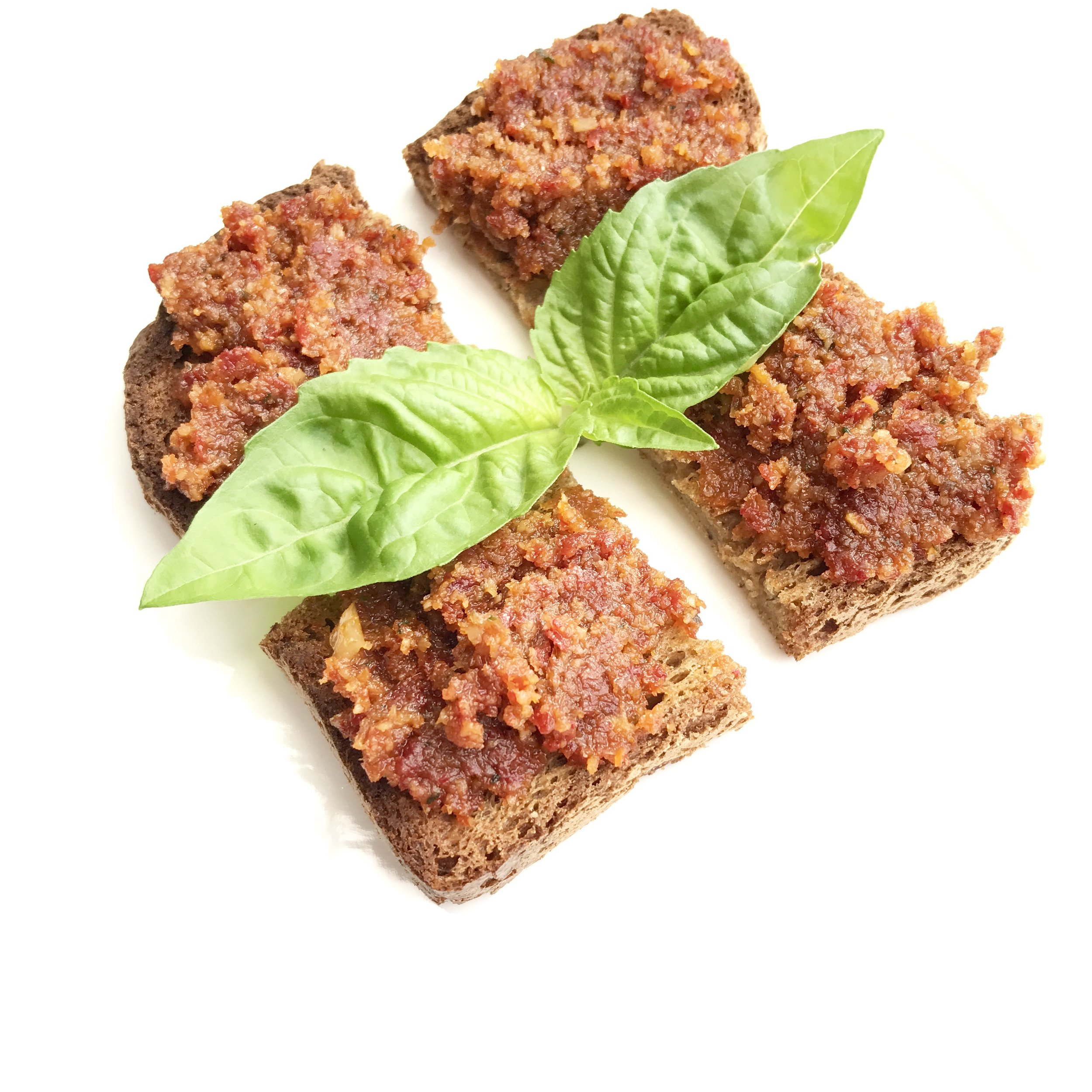 Sundried tomatoes, soaked walnuts, garlic, salt, fresh basil and sage blend up to make the most perfect sweet and savory pate. Pictured served on gluten-free toast.