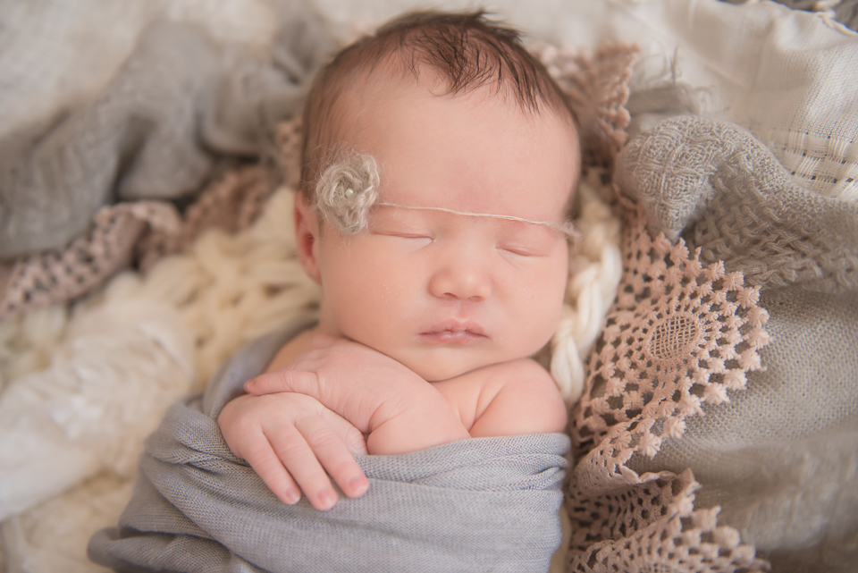 sleepy newborn girl
