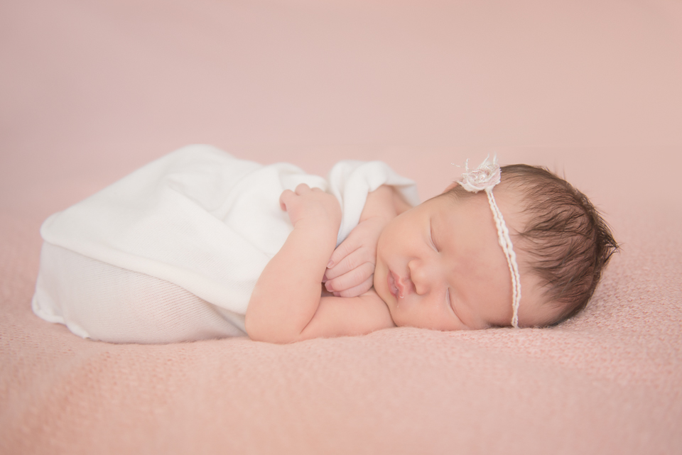 baby girl on pink with headband