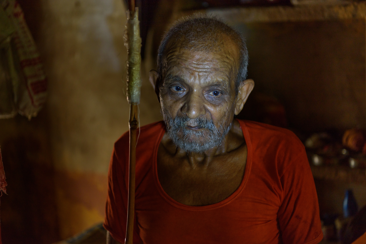 Rajnarayan Ashram, 80, in his room at the Mumukshu Bhawan in Varanasi.