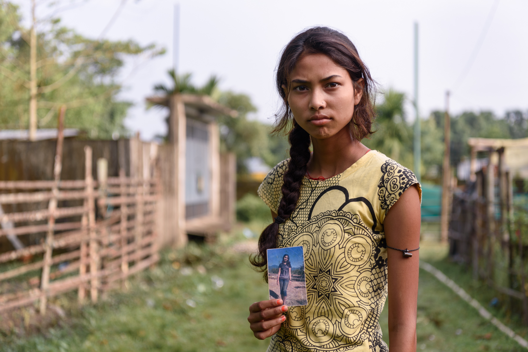 Binita Biswakarma, 15, with a photograph of her sister Ranjana. Ranjana, 16, has been missing since 2009. She was trafficked by her uncle while travelling with him for a family wedding. Binita's parents are illiterate and never filed a police report until two years ago, following Binita's continued persuasion.