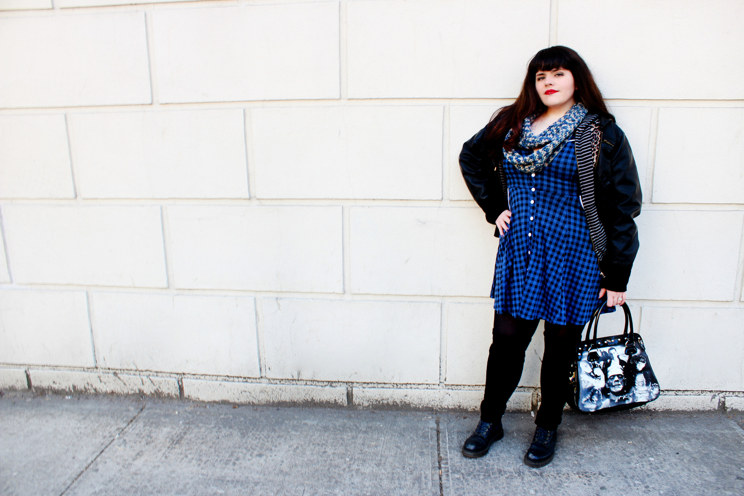 What She's Wearing:  Jacket/ Forever21 , Hoddie/???, Scarf/  Hatsscarfsmittensohmy , Bag/  Sourpussclothing.com  , Dress/  Sourpussclothing.com  , Tights/???, Leg-Warmers/???, Boots/ DrMartens