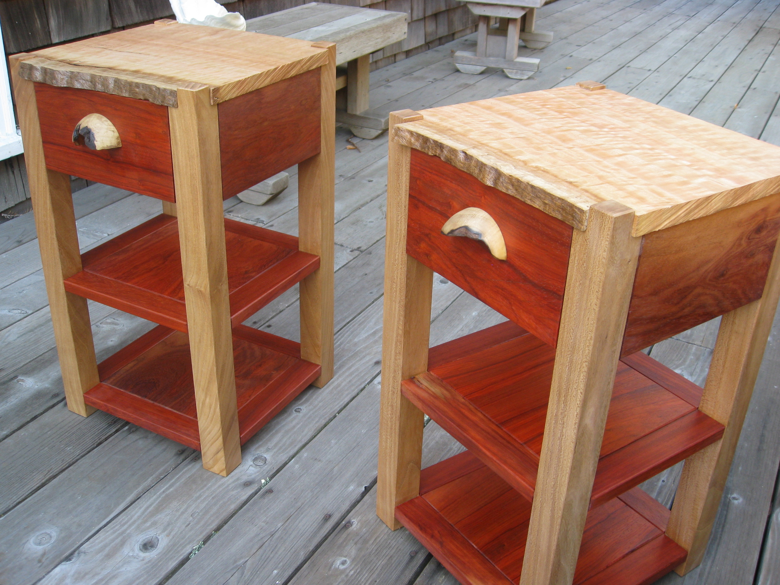 Twin Nightstands. Looking to bring a little color to a wanting bedside, I used Padauk, Elm, Eucalyptus and turned California Bay. To follow the character of the Eucalyptus top and it's natural edge, I used a chain saw to treat the other edges.