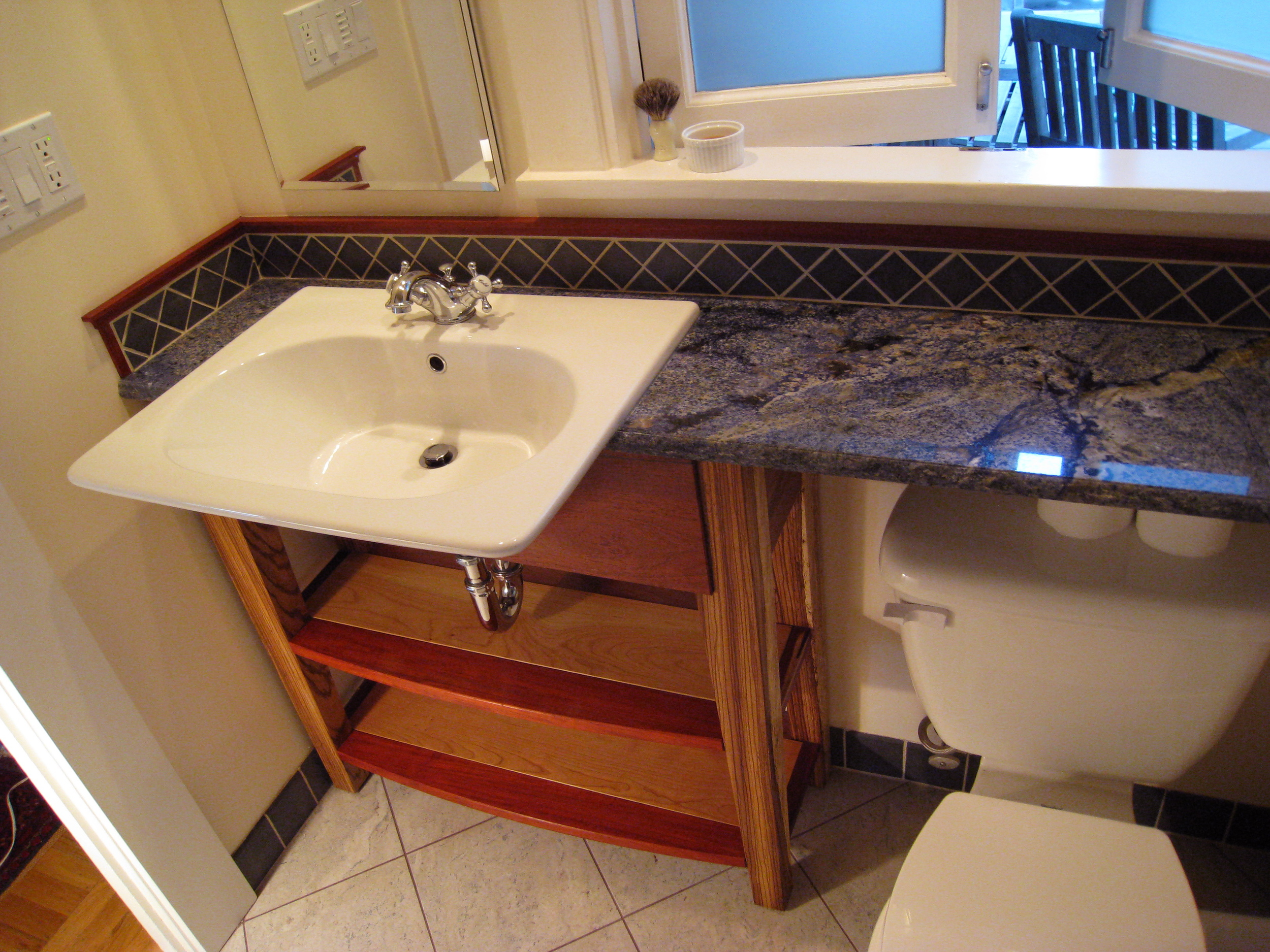I tried to match the splendor of this blue granite countertop with some exotic hardwoods; Padauk and Zebrawood.