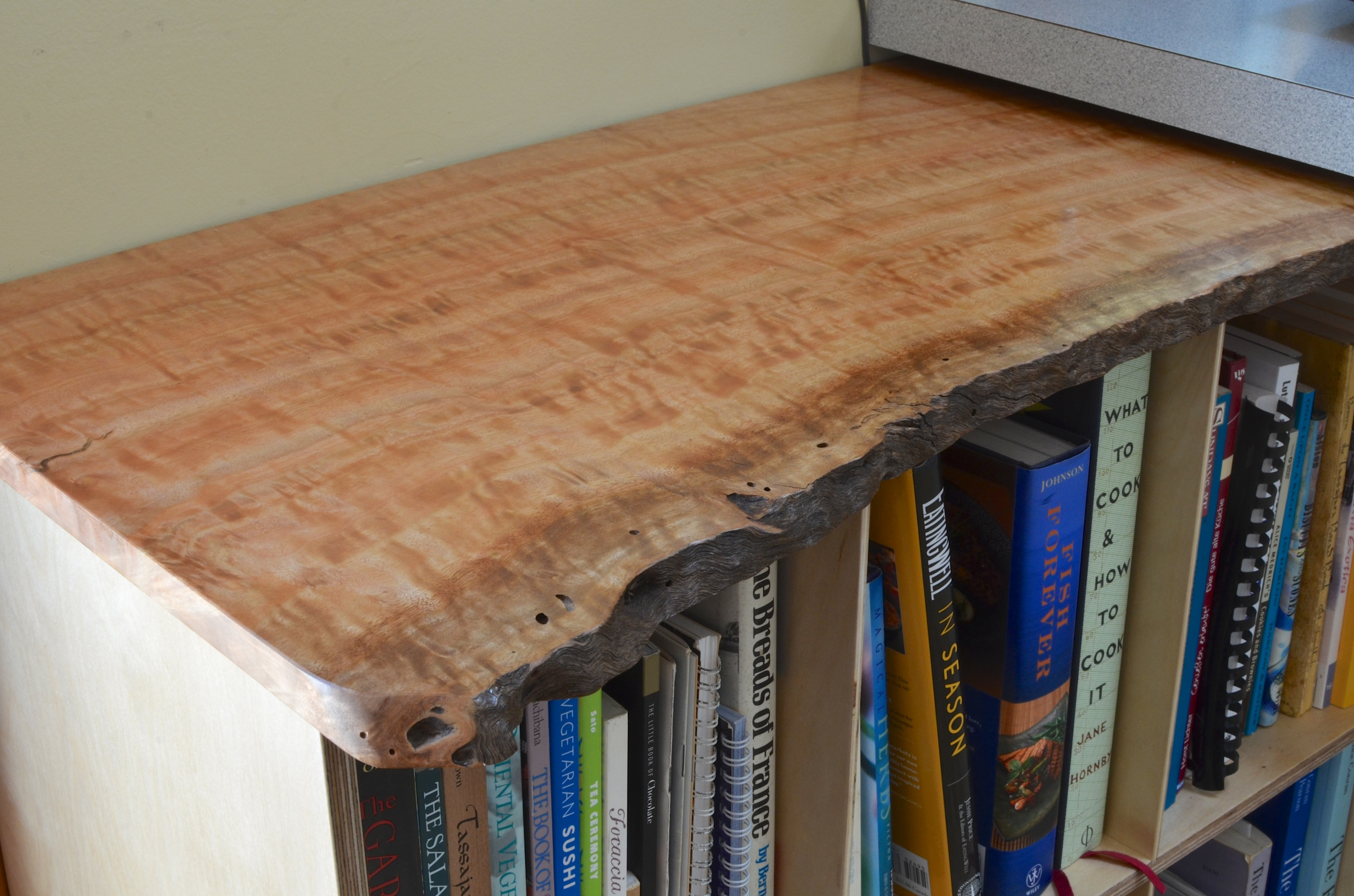 Cookbook Shelf. A piece of figured eucalyptus and birch fin-ply made a nice home for some formerly free ranging cookbooks.