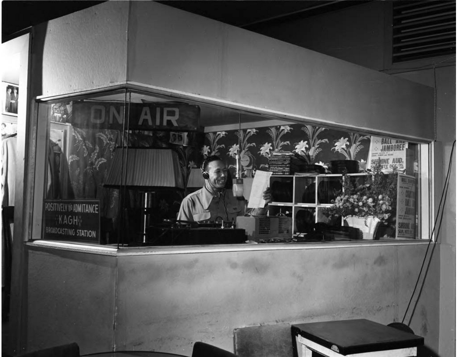 Bill Sampson in the radio booth -   Photo Courtesy of Charles Williams Collection, Tom & Ethel Bradley Center, CSUN
