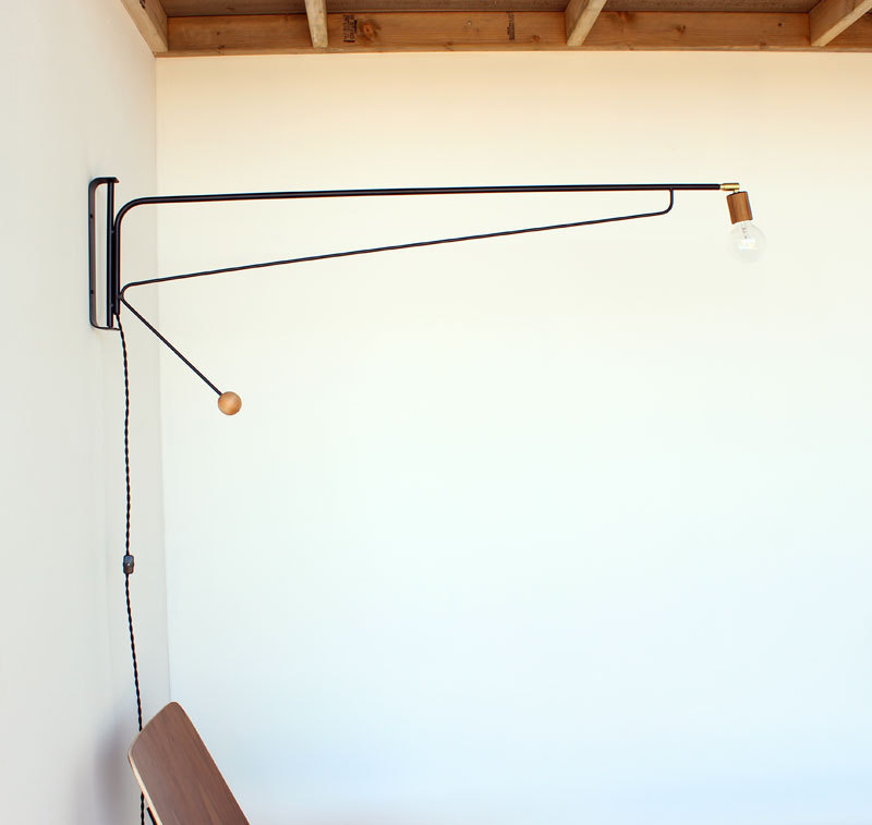 "Otis wall light 48"", $275"