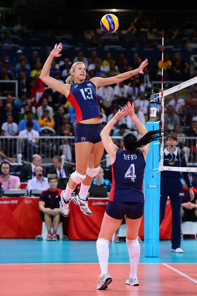 Aug 11, 2012; London, United Kingdom; USA middle blocker Christa Harmotto (13) receives the set from USA setter Lindsey Berg (4) in the women's indoor volleyball gold medal match against Brazil during the London 2012 Olympic Games at Earls Court. Mandatory Credit: Kyle Terada-USA TODAY Sports