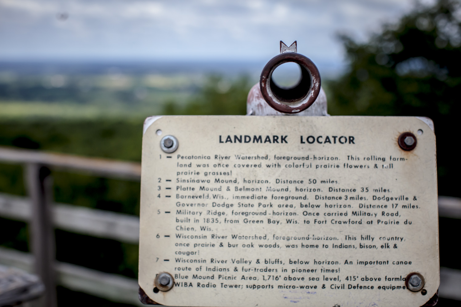 An observation tower in the Wisconsin river valley points to #6 of interesting geological landmarks. Where the buffalo roamed.
