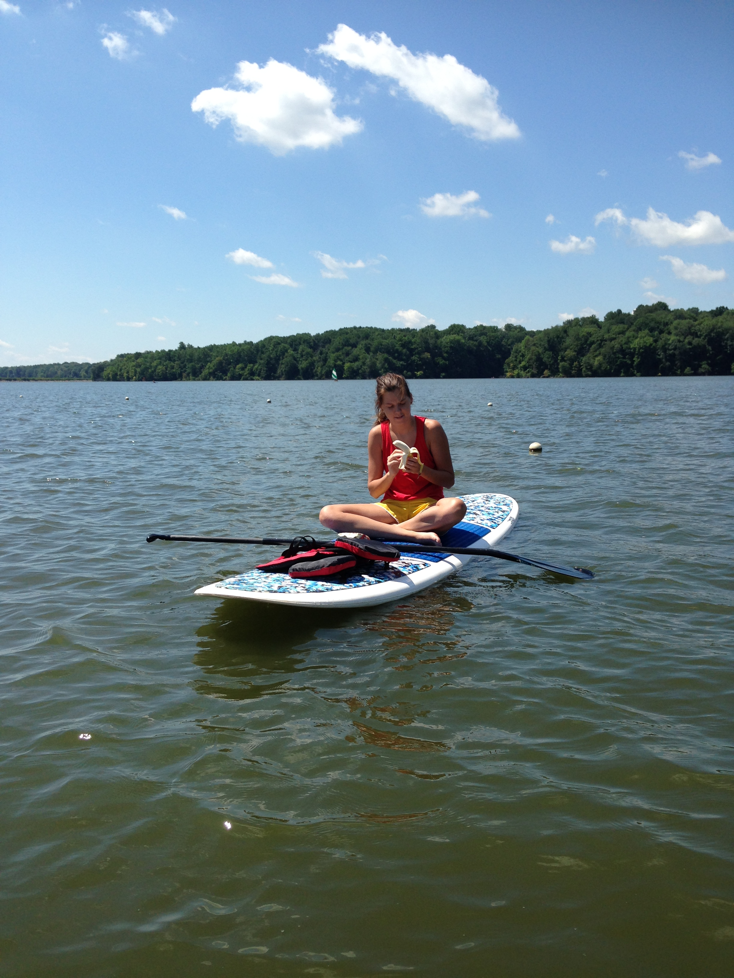 Snacking on the paddle board.