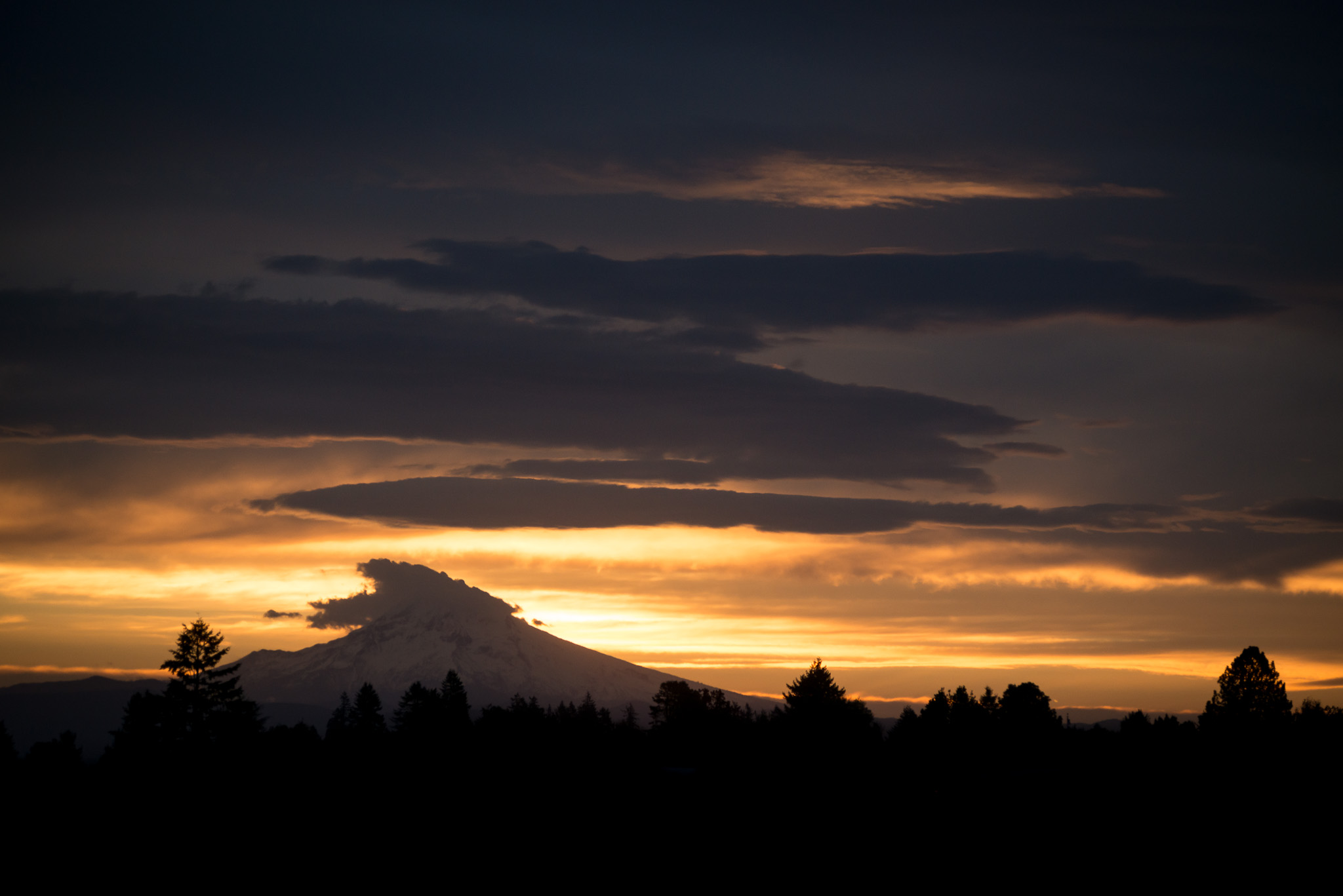 This is Mount Hood, seen at sunrise, from a field two blocks from our apartment. How cool is that?