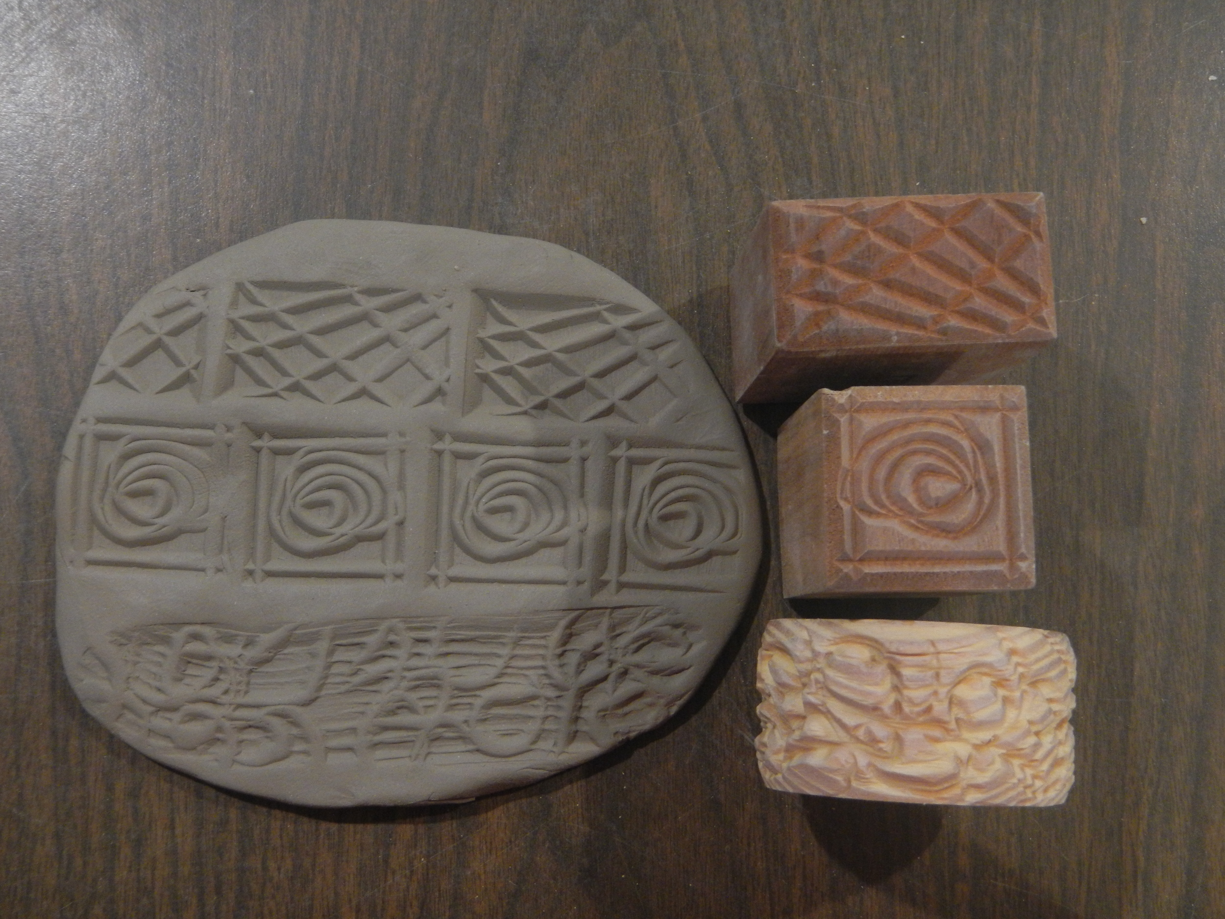 (Mecca Pottery tools.The square and rectangle stampshavedifferent designs cut into the other ends.)