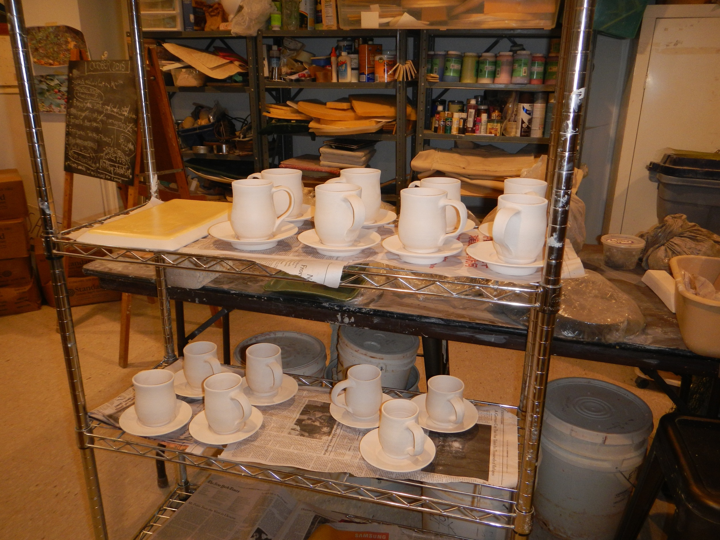 cups and saucers for a good customer, bisqued and ready to be glazed
