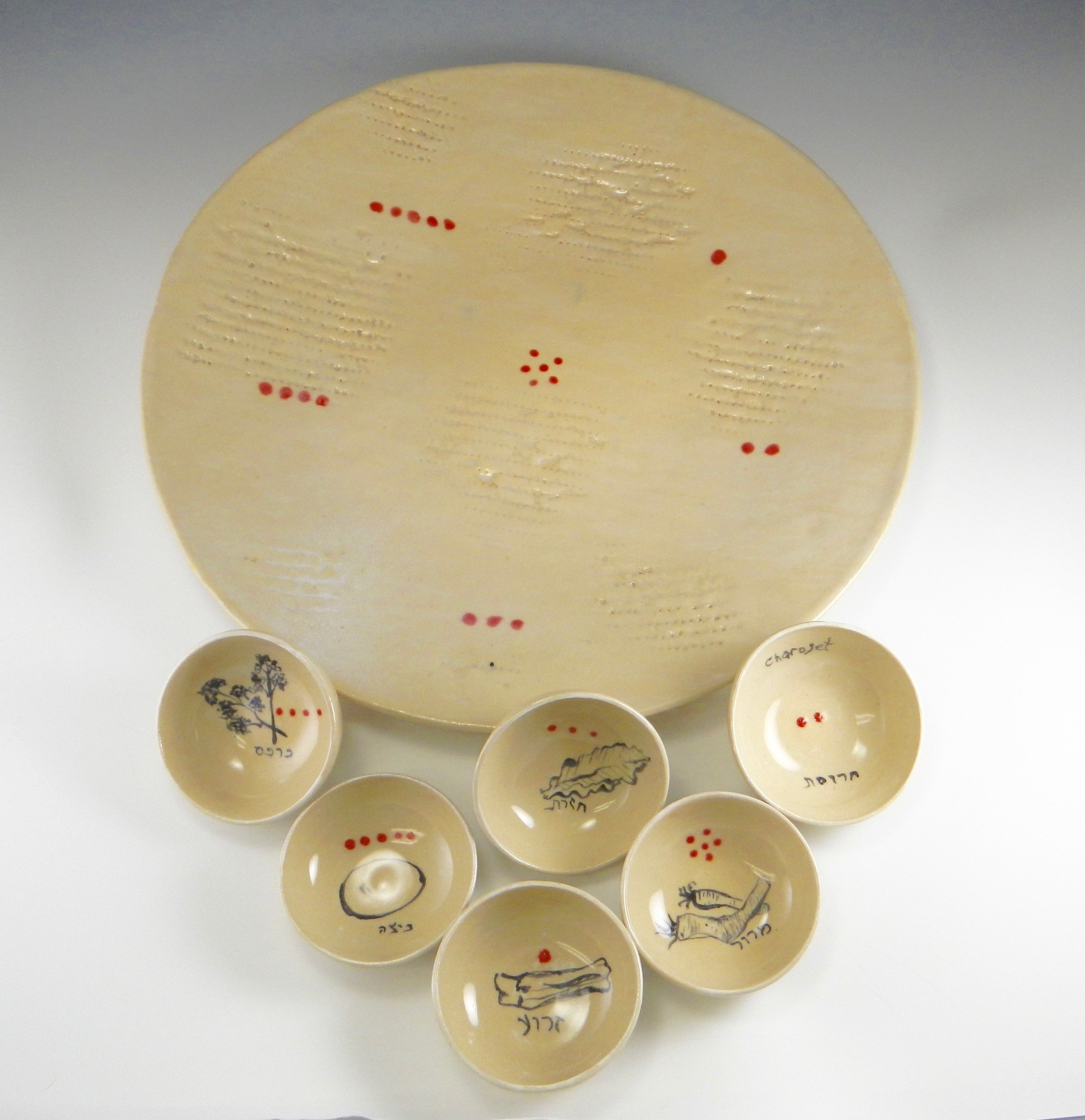 """(Matzah-textured 17"""" Seder plate, color coded for placement of 3.5"""" small dishes. 2016 Mimi Stadler Pottery)"""