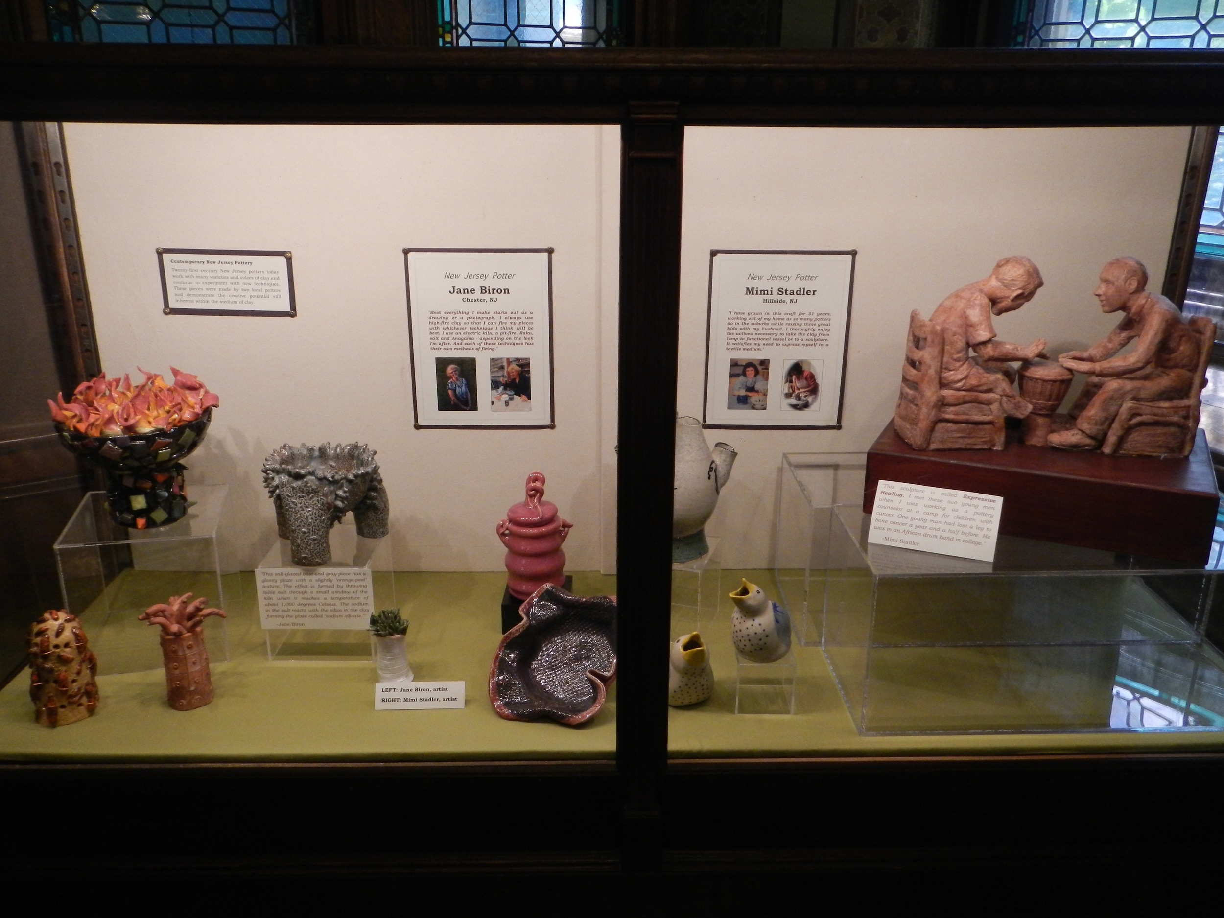 In the case at METC (photo, Mimi Stadler 2016) My work starts from the raspberry colored jar and to its right; Jane Biron's the 4 pieces to the left.