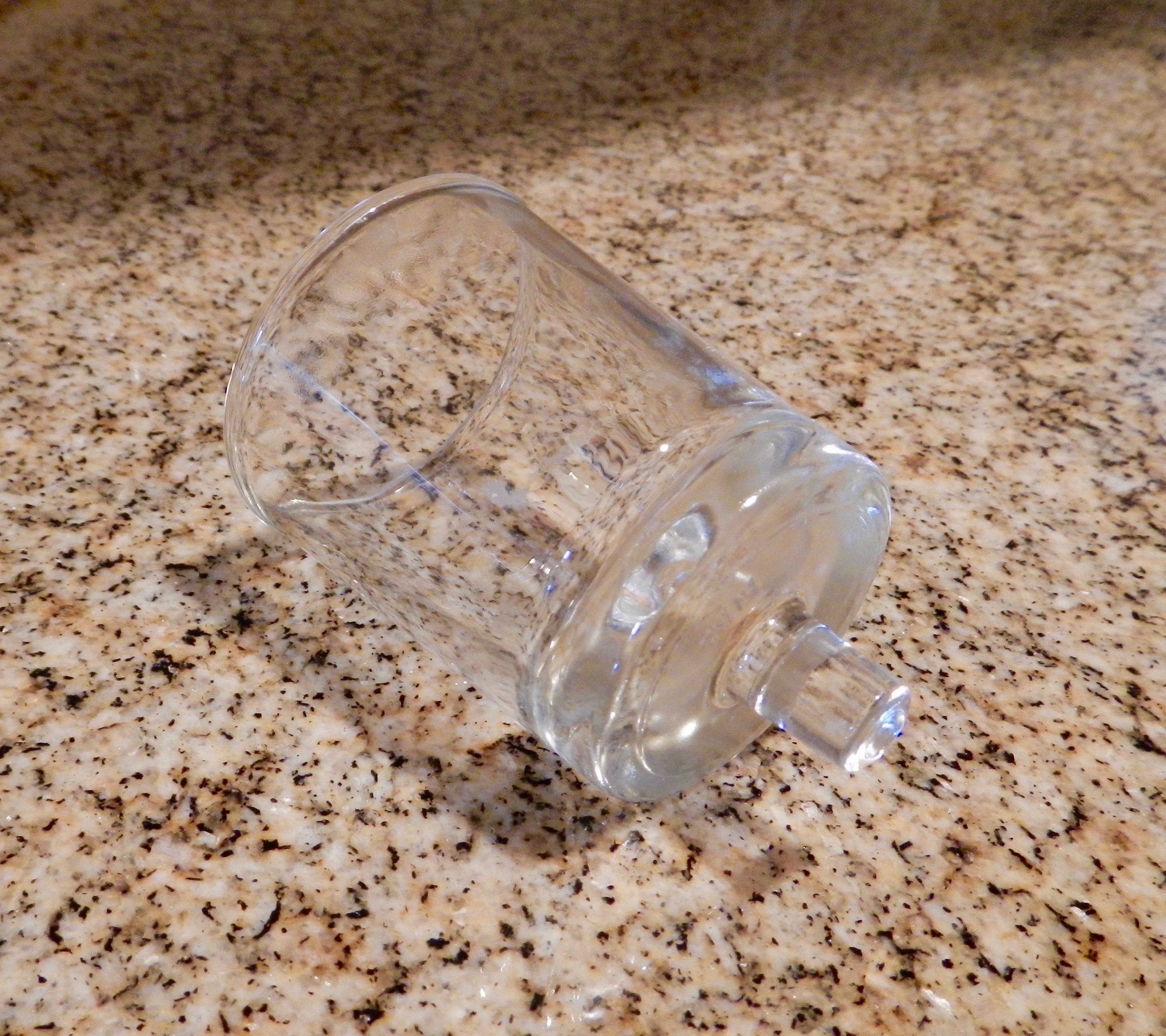 (Shown: Glass cup for oil or candle. They come in different widths and nub sizes.)